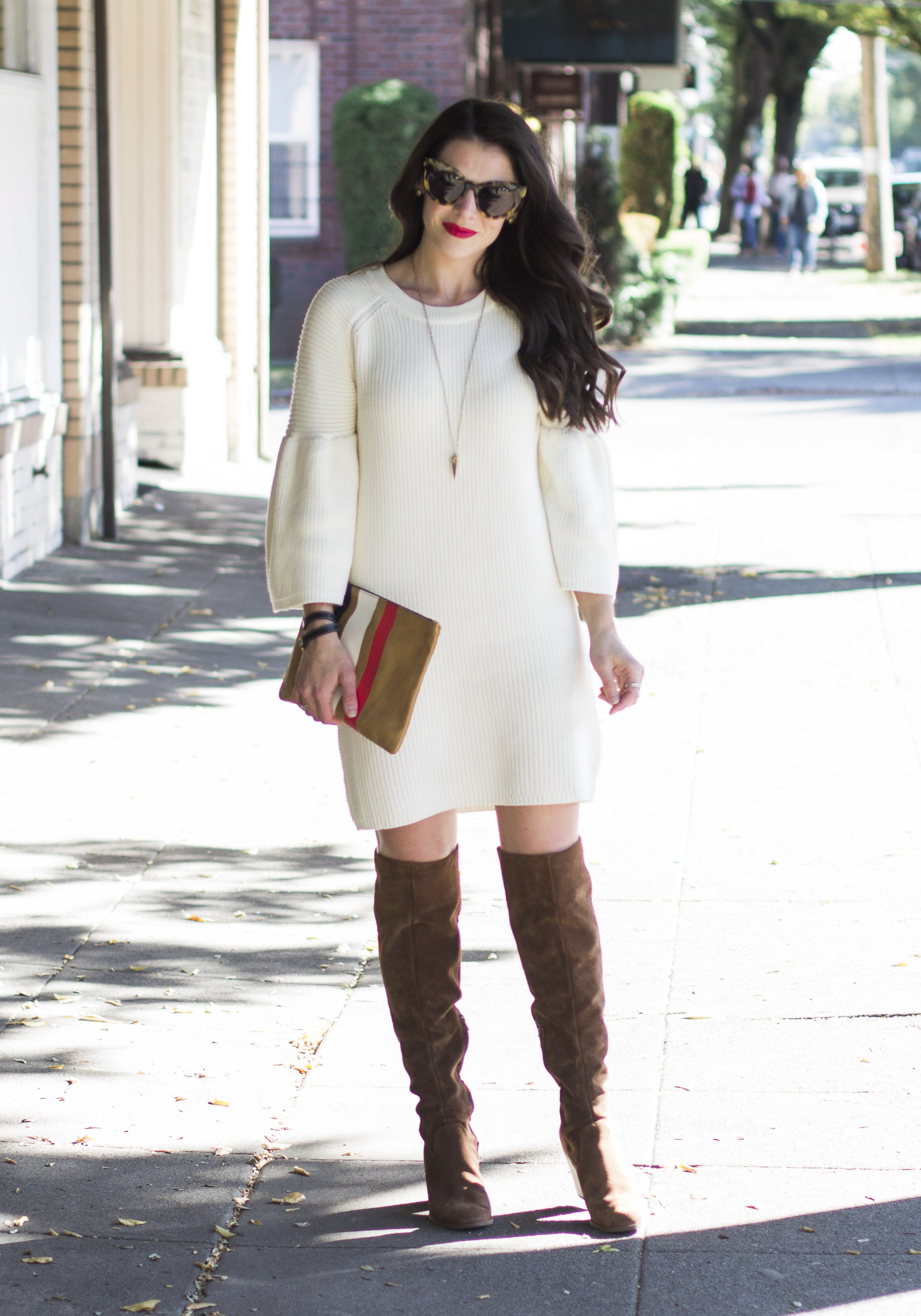 Cute over the knee boot outfits, outfit ideas for fall, sweater dress with bell sleeves and Steve Madden Eternul OTK boots.