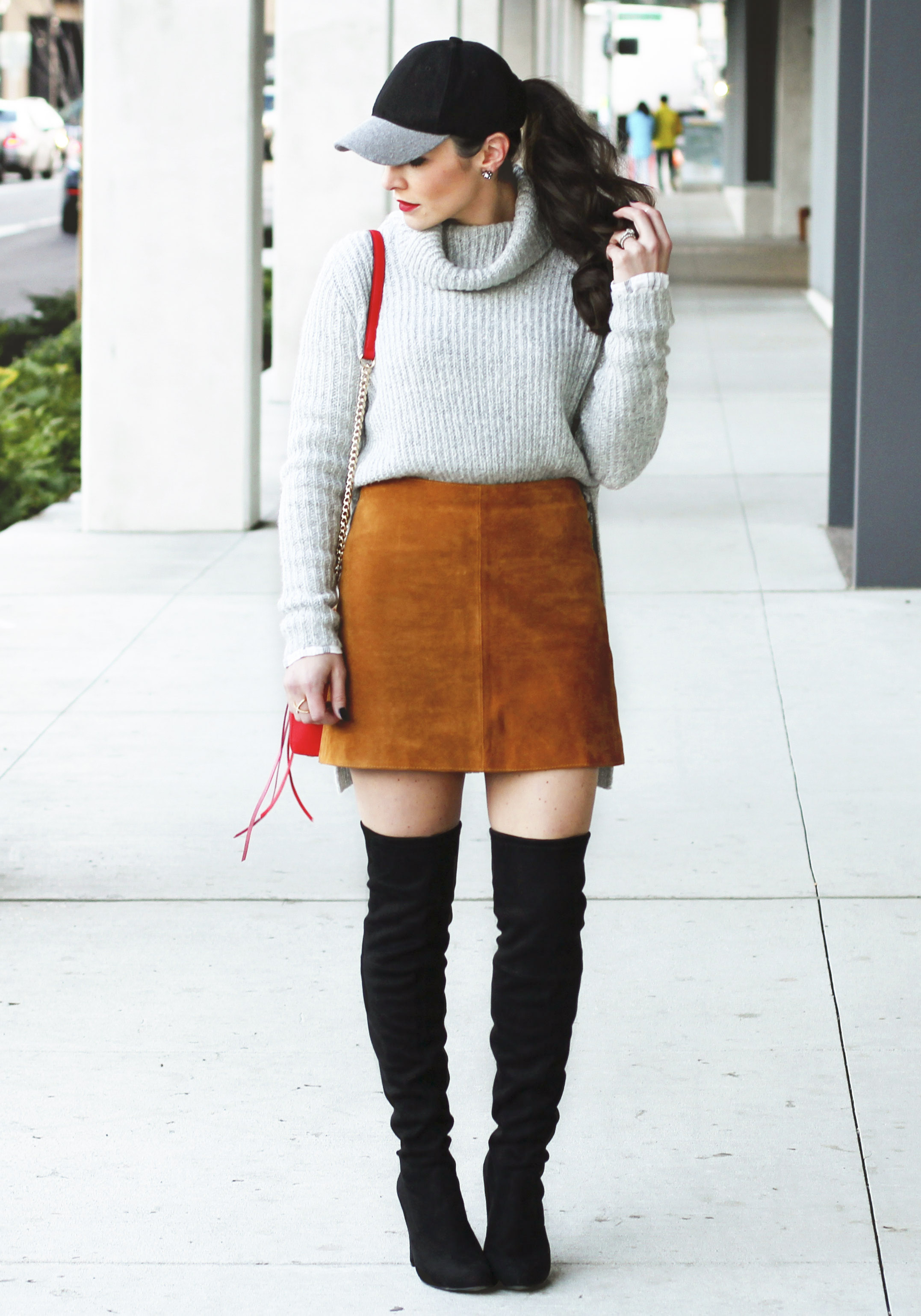 Over the knee boot outfit ideas, cute fall outfits.  Suede skirt with side slit sweater and wool baseball hat, Steve Madden Gorgeous over the knee boots.