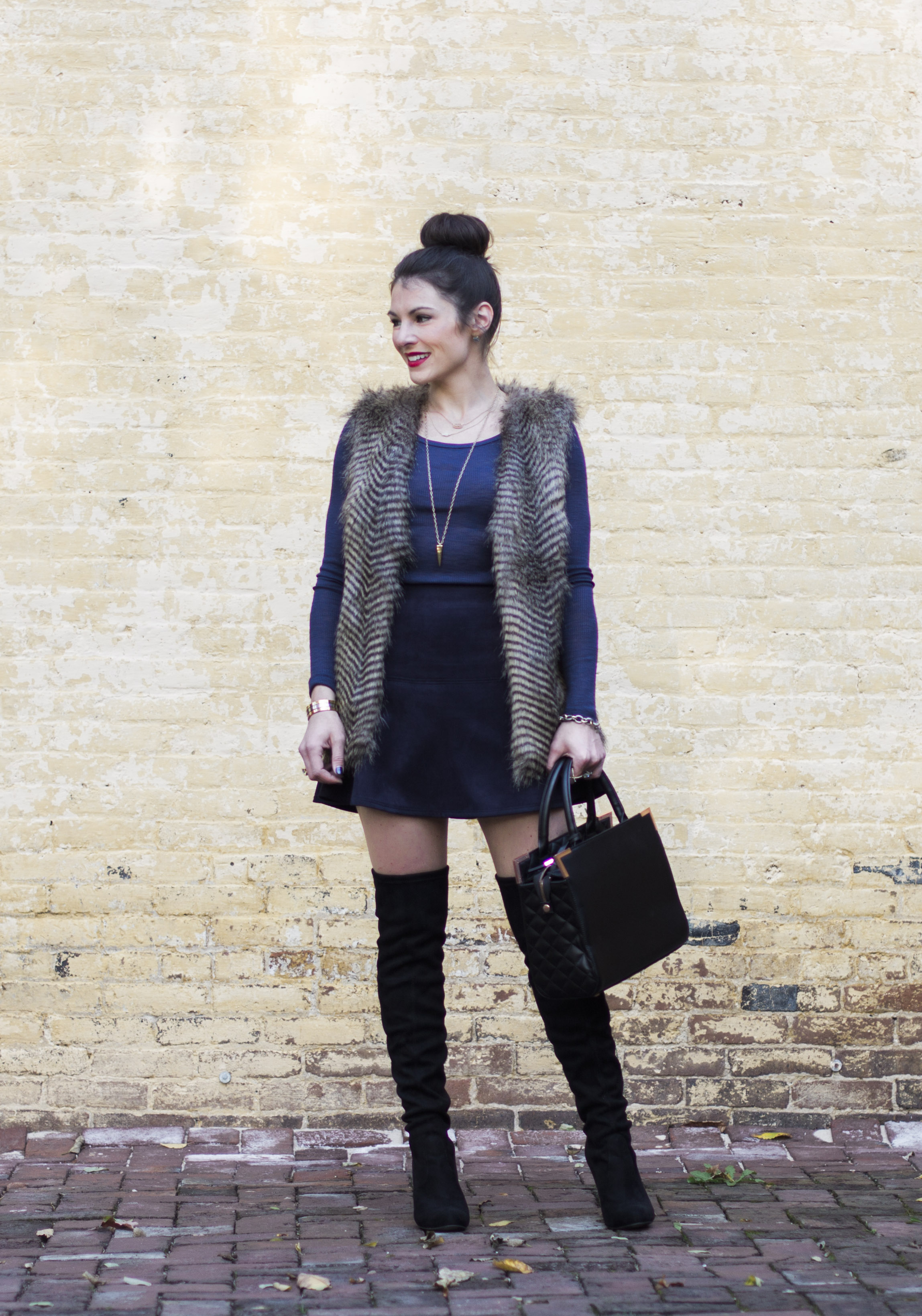 Cute fall outfit- faux suede skirt, faux fur vest, long sleeve tee, Steve Madden Gorgeous over the knee boots, and black Oliver Bilou handbag.