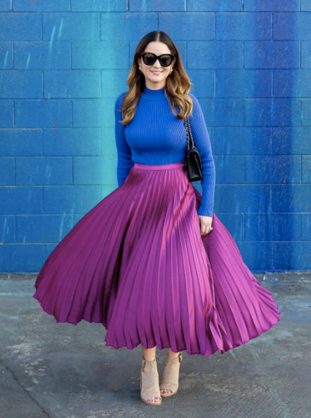 How to style a pleated midi skirt, color blocked outfit, blue turtleneck sweater, purple satin pleated midi skirt.