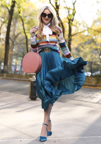 How to style a pleated midi skirt, striped sweater, blue satin pleated midi skirt, and a bow blouse.