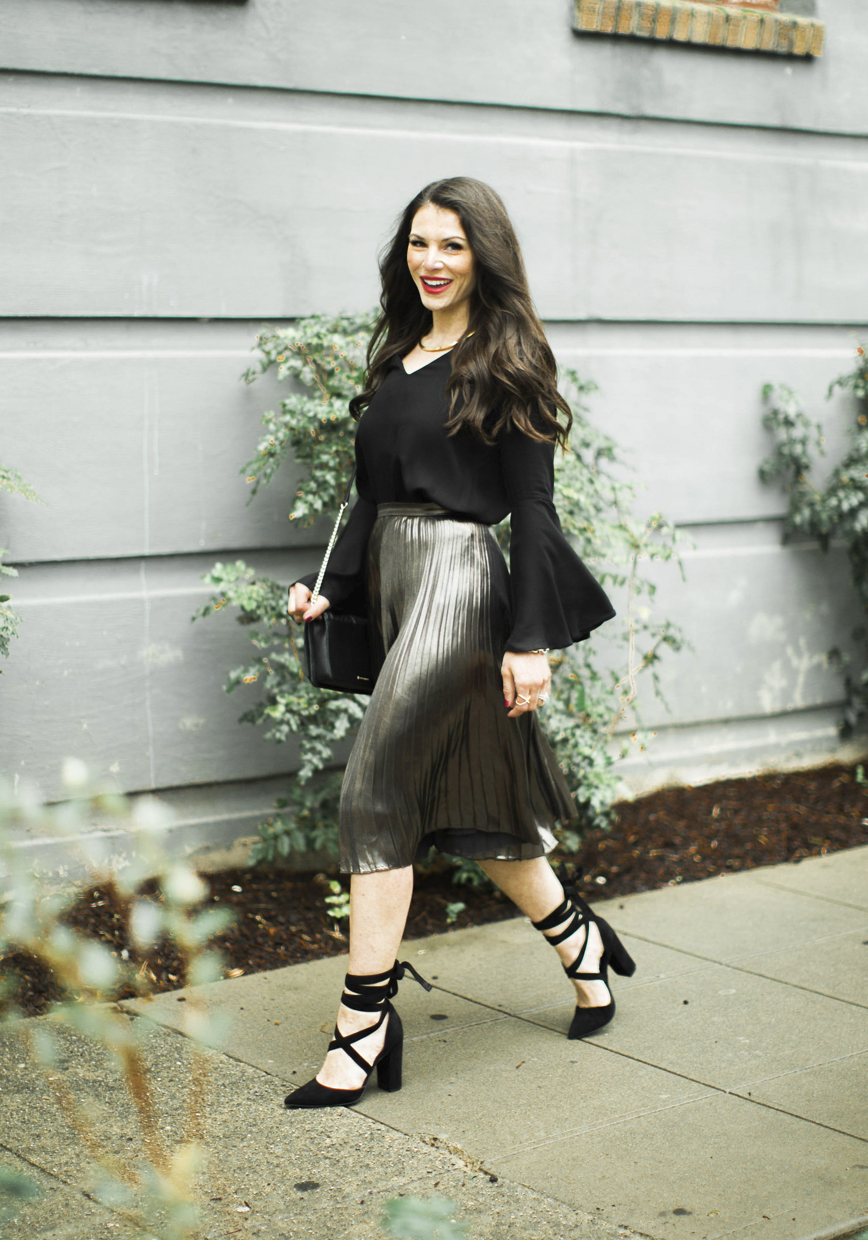 NYE outfit, metallic pleated midi skirt, bell sleeve blouse, Steve Madden Bryony Pumps, & Rebecca Minkoff Love crossbody bag.
