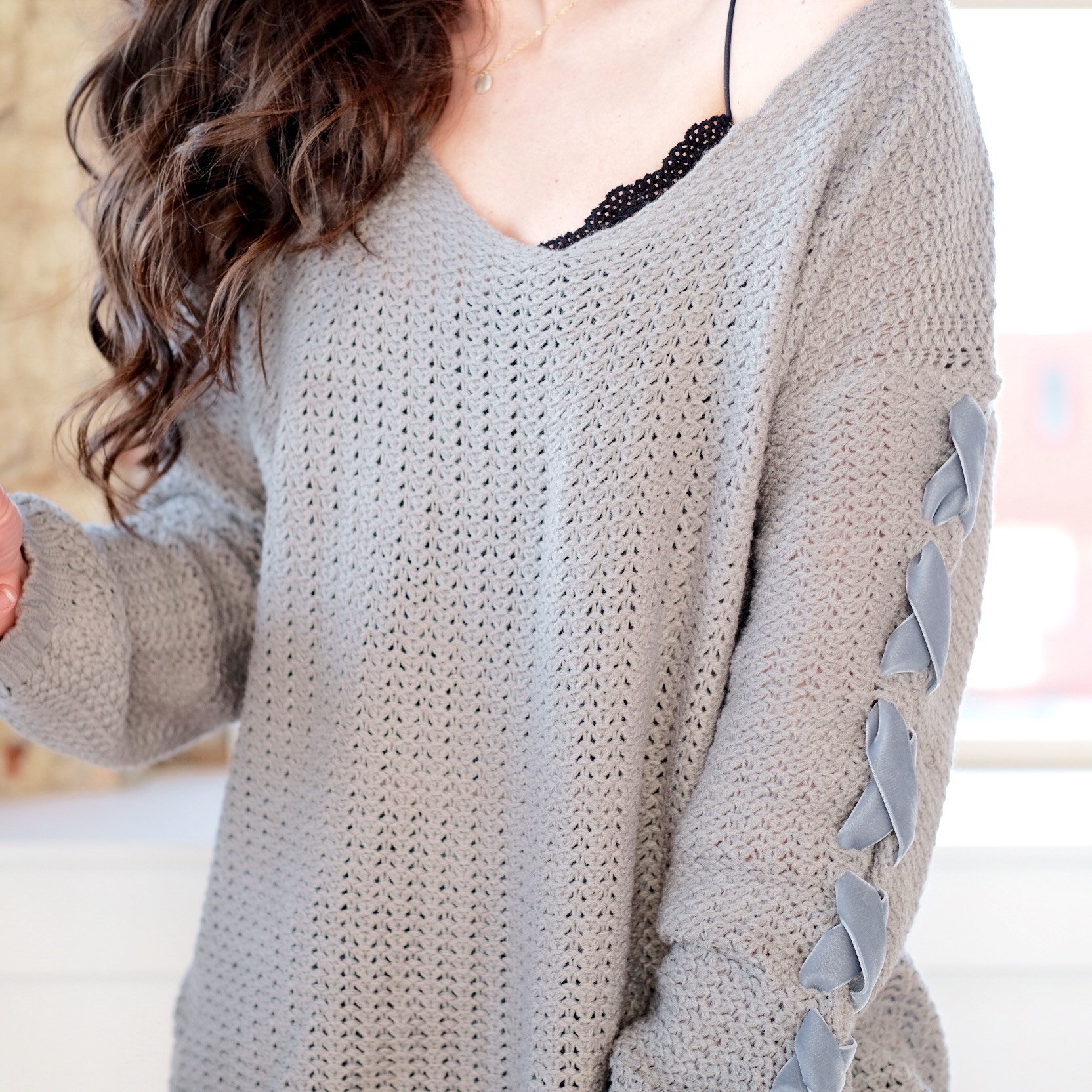 DIY lace up sleeve sweater with bow, fun winter DIY, cute sweater.