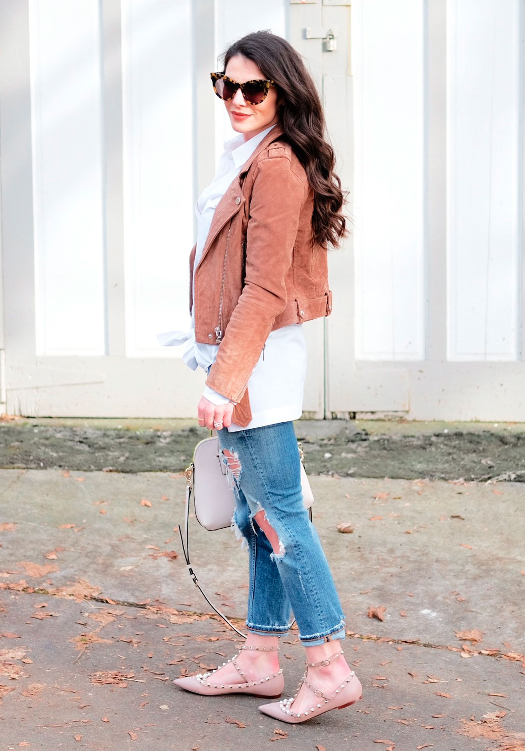 Cute winter outfits.  Blank NYC morning suede moto jacket with destroyed girlfriend jeans, Valentino rockstud flat dupes, oversized white shirt, and Karen Walker sunglasses.