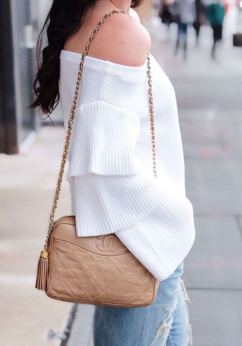 Endless Rose off the shoulder tiered sleeve top sweater, Destroyed boyfriend jeans, lace-up flats, and vintage Chanel handbag.