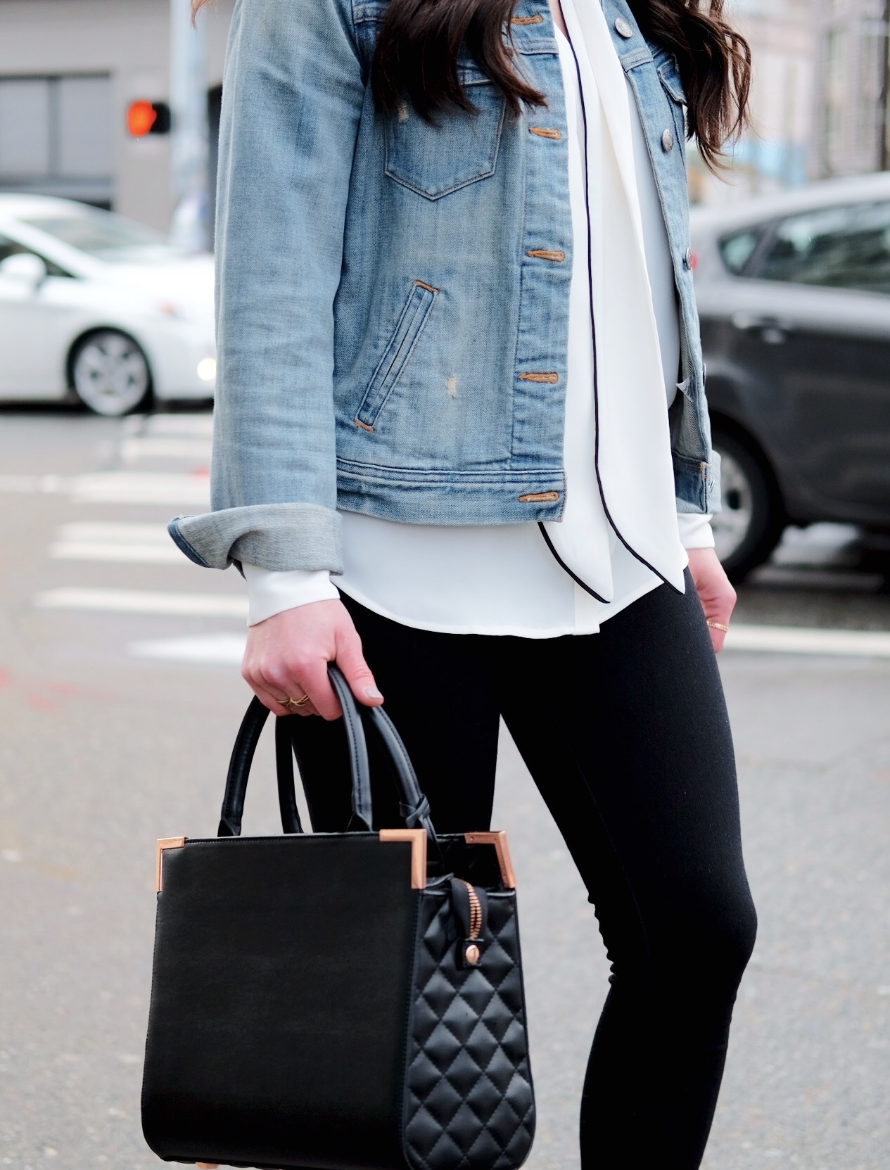 Cute spring outfit to wear to work.  J.Crew denim jacket, bow blouse, black skinny jeans, and Oliver Bilou handbag.