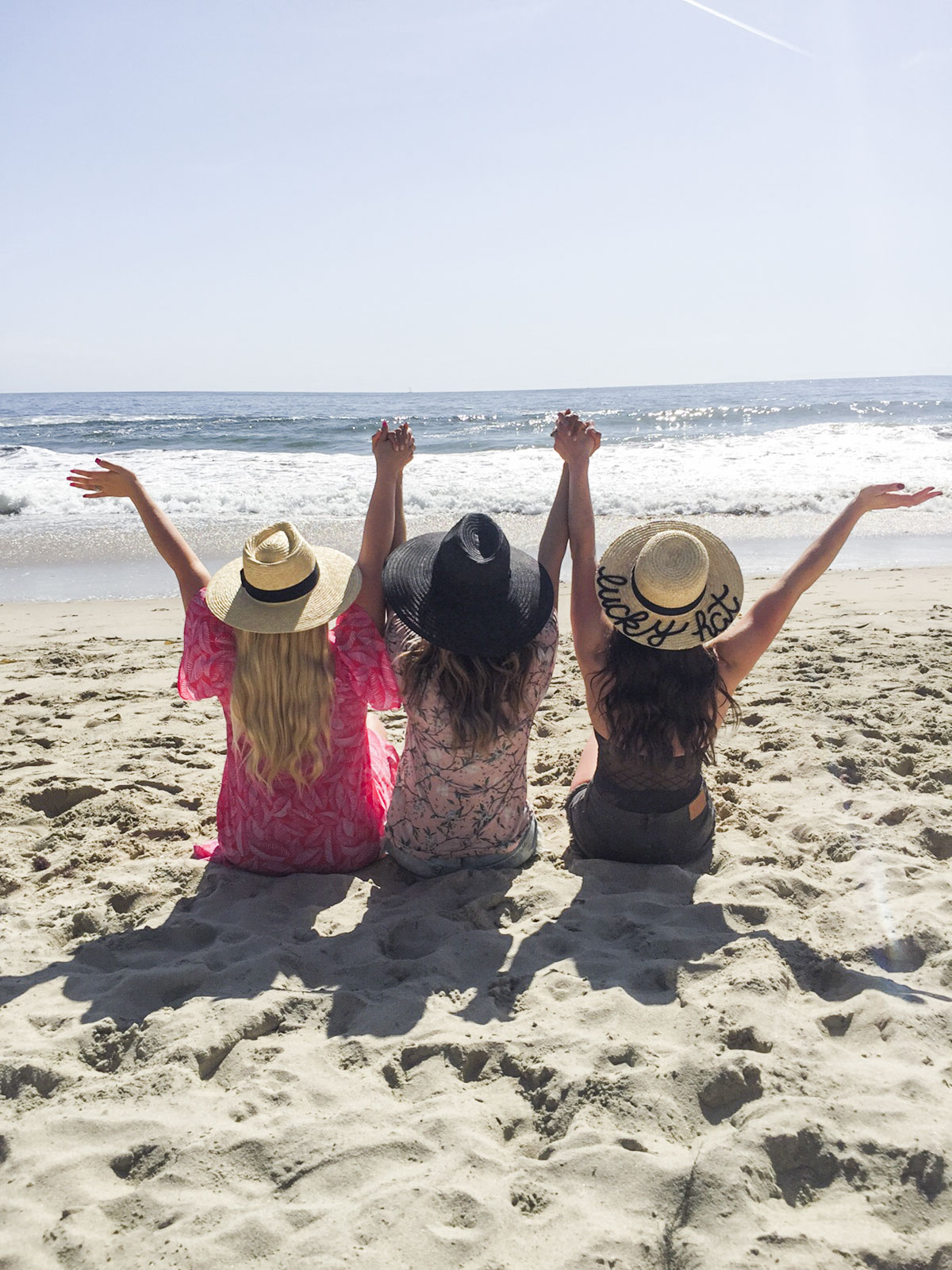 Cute photo of girlfriends on the beach, cute beach hats, DIY Eugenia Kim hat.