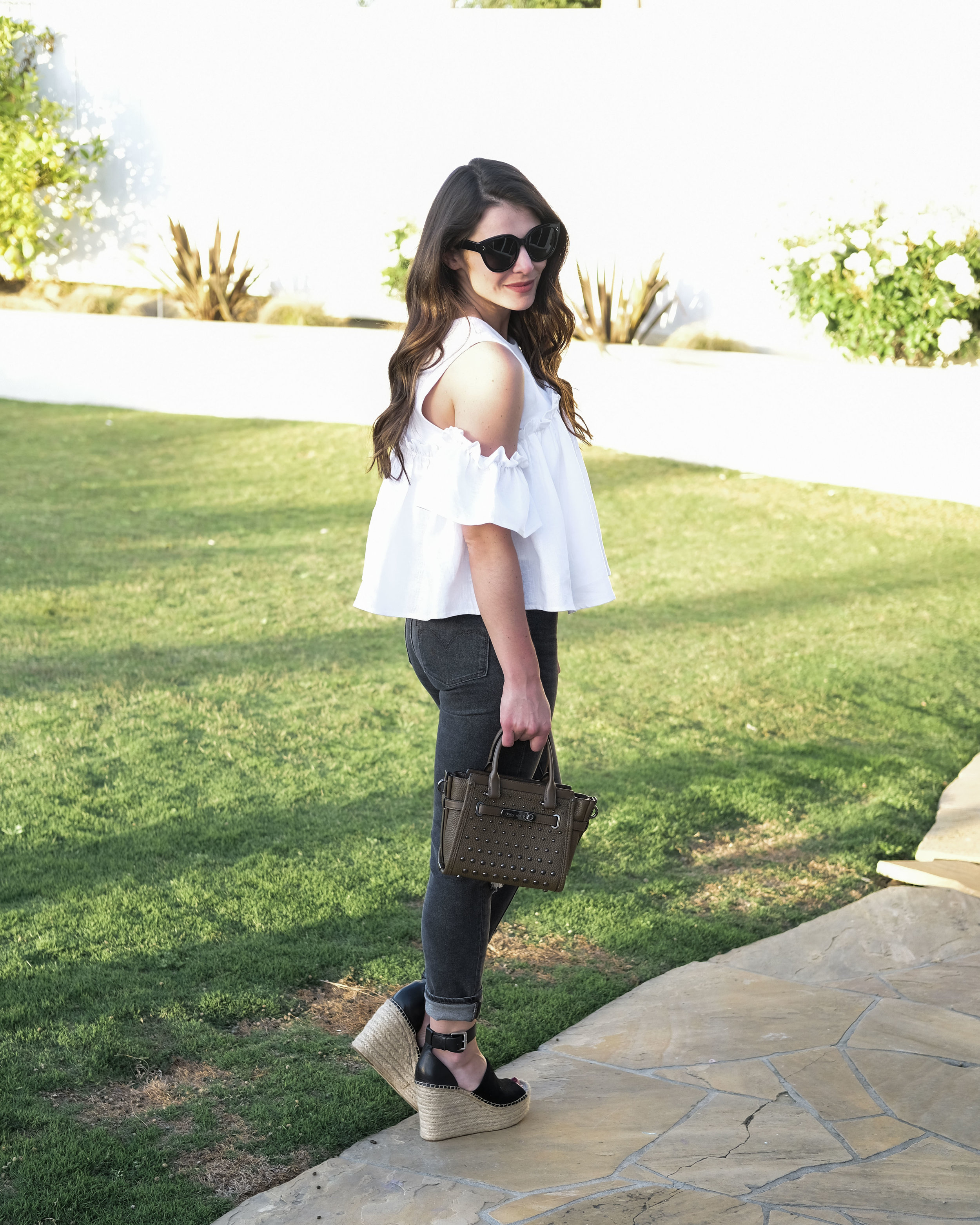 J.O.A. linen cold shoulder top, Levi's 721 high rise skinny jeans, Marc Fisher Adalyn wedges in Black, Coach swagger bag, Celine Audrey sunglasses.  Cute outfit for California vacation.