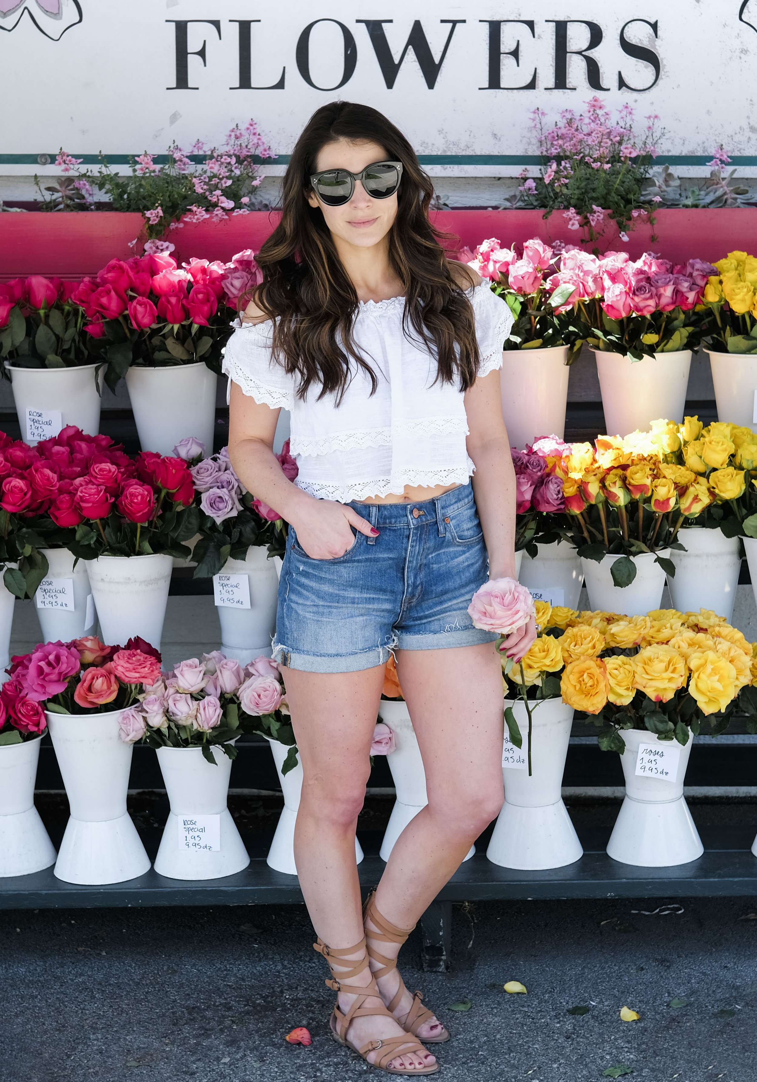 Madewell high waist cuffed denim shorts, Rip Curl Atlas off the shoulder crop top, Joes Jeans gladiator sandals, Celine audrey sunglasses.  Cute outfit to wear on vacation or at the beach.