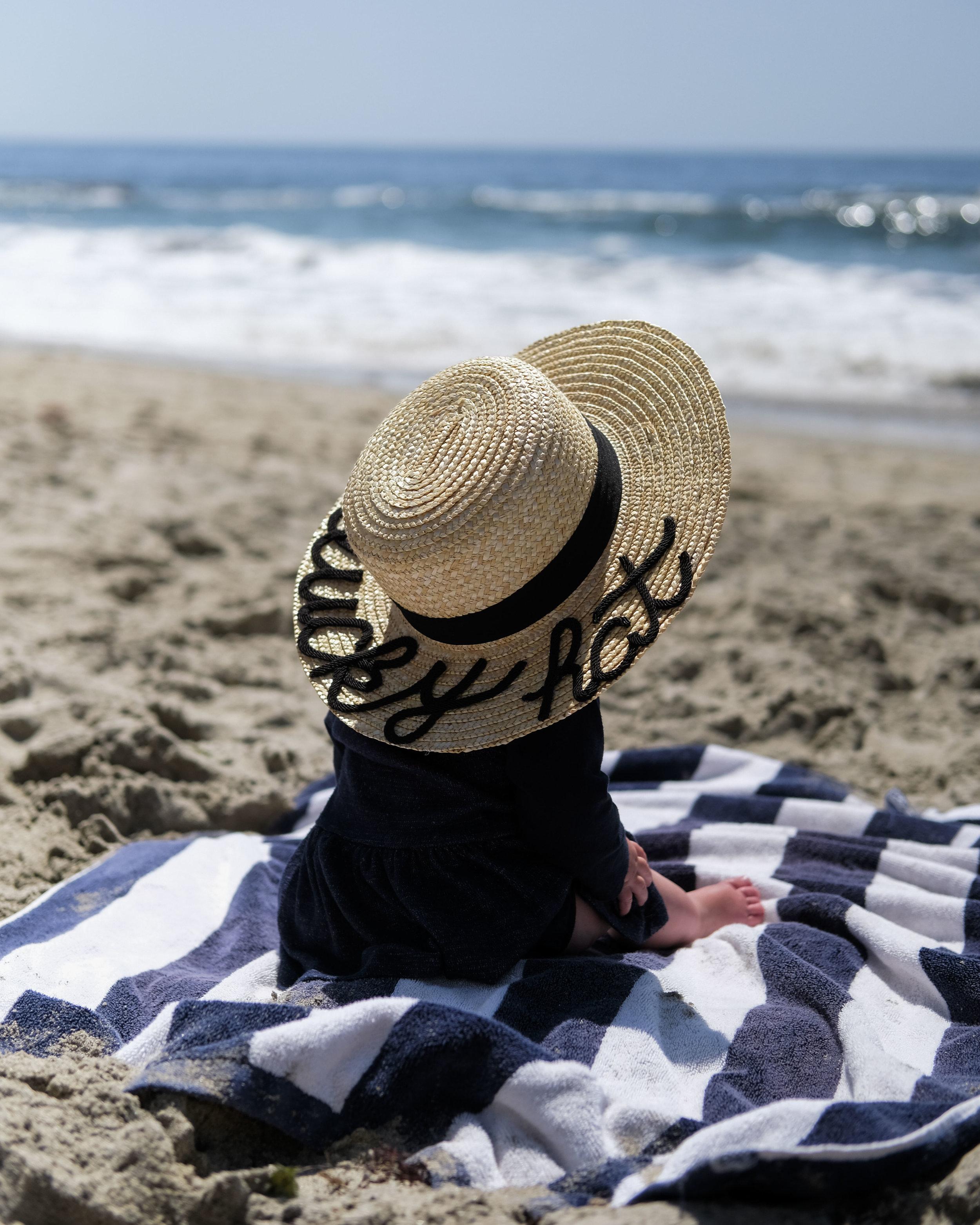 Baby portrait on the beach, DIY Eugenia Kim hat, casual family photos.