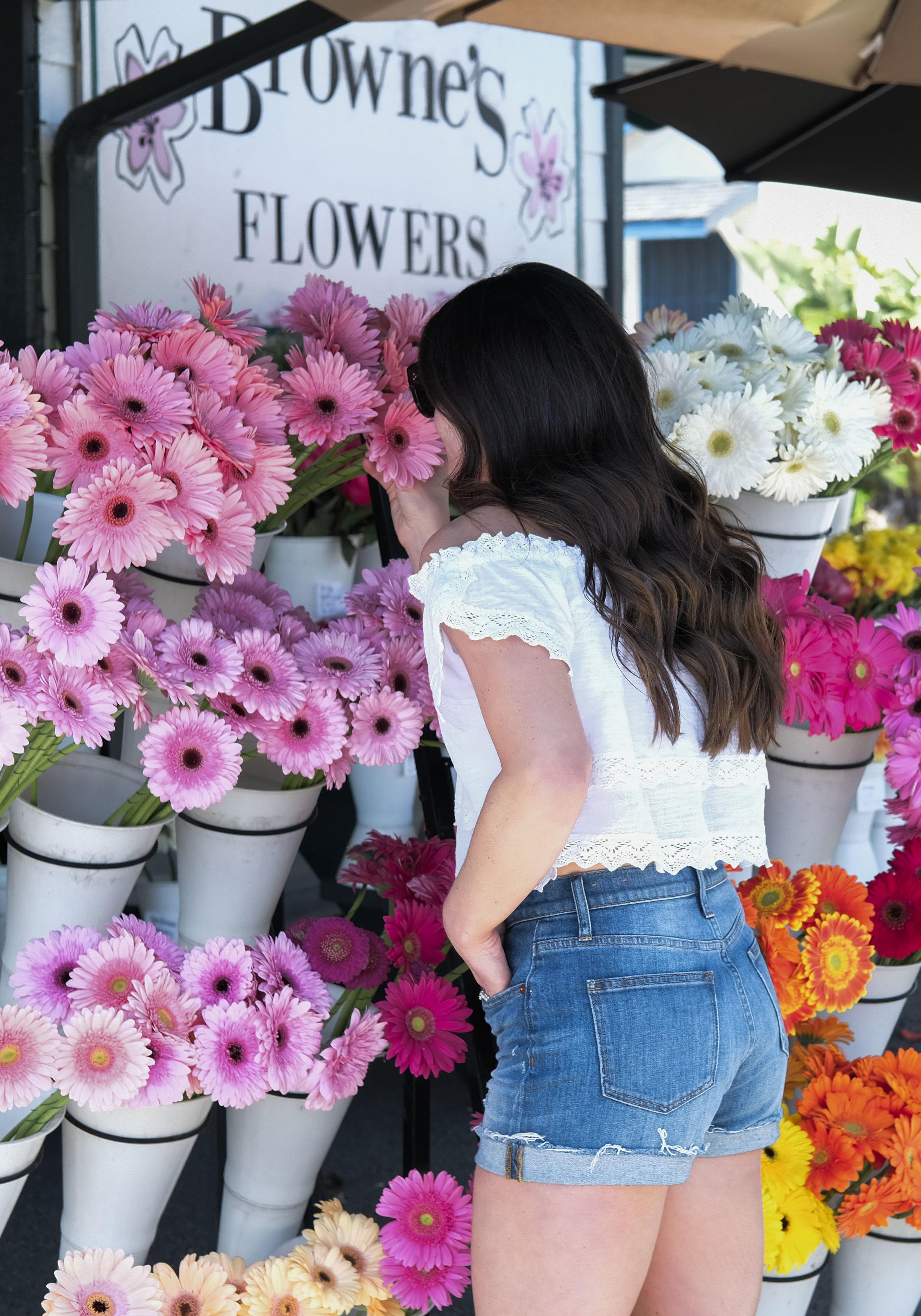 Madewell cuffed high waist denim shorts, Rip Curl Atlas Off the shoulder crop top, Browne's flower shop in Dana Point, Guide to Laguna Beach.