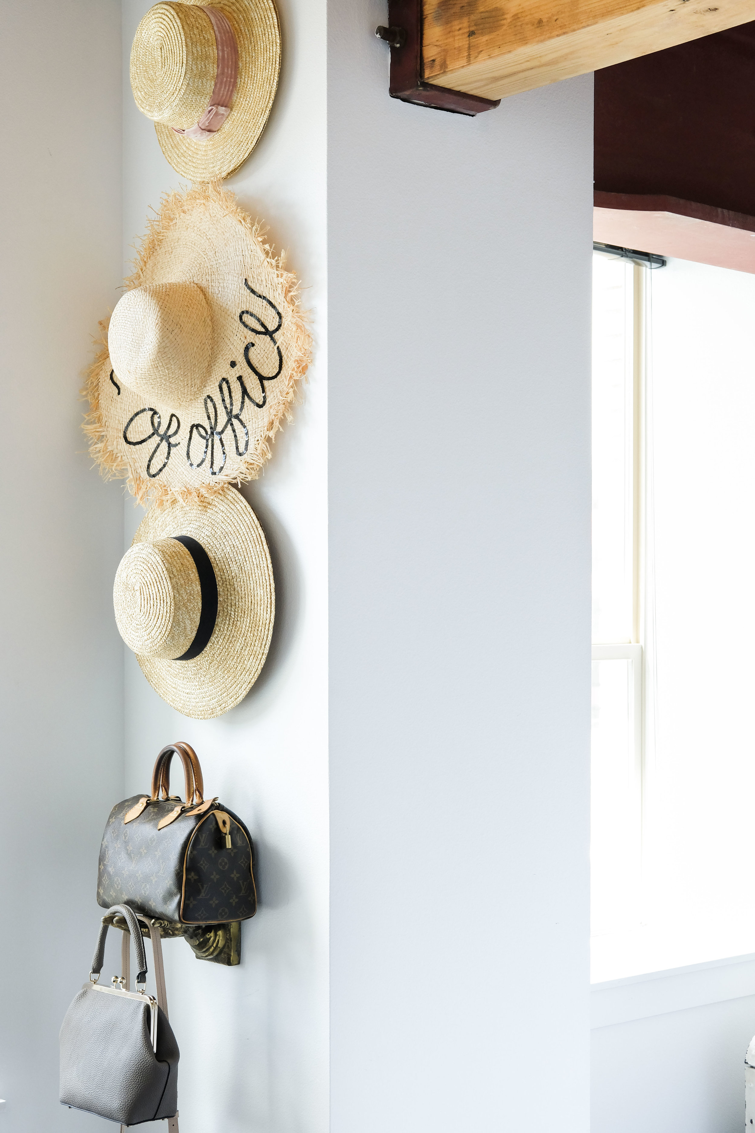 Modern loft decor.  Storage hacks for small bedrooms.  Hats and handbags display like a gallery wall.