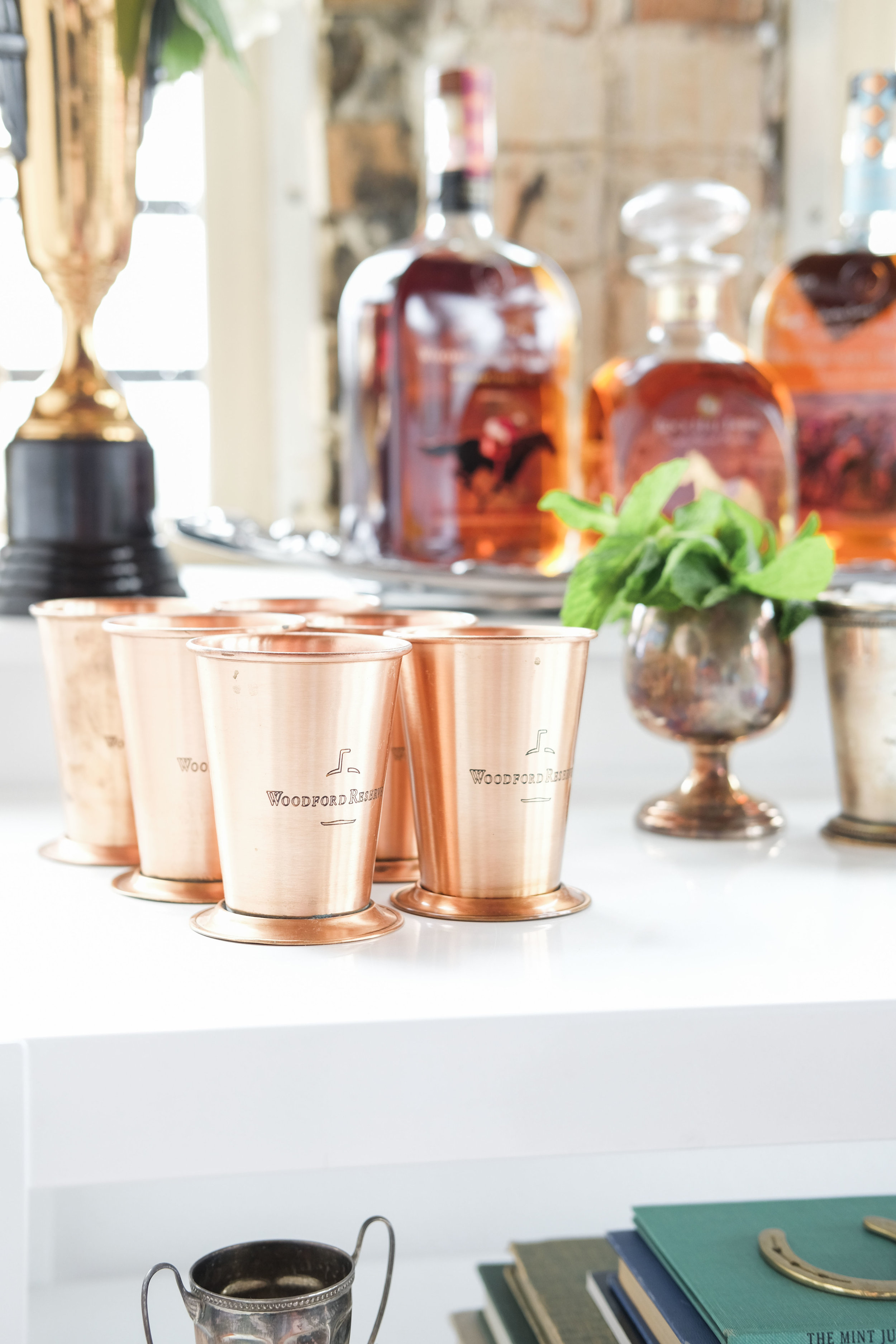 Kentucky Derby Party inspiration.  Mint Julep bar cart.  Trophy cup vase, Woodford Reserve bourbon, vintage Kentucky Derby books, equestrian home decor.