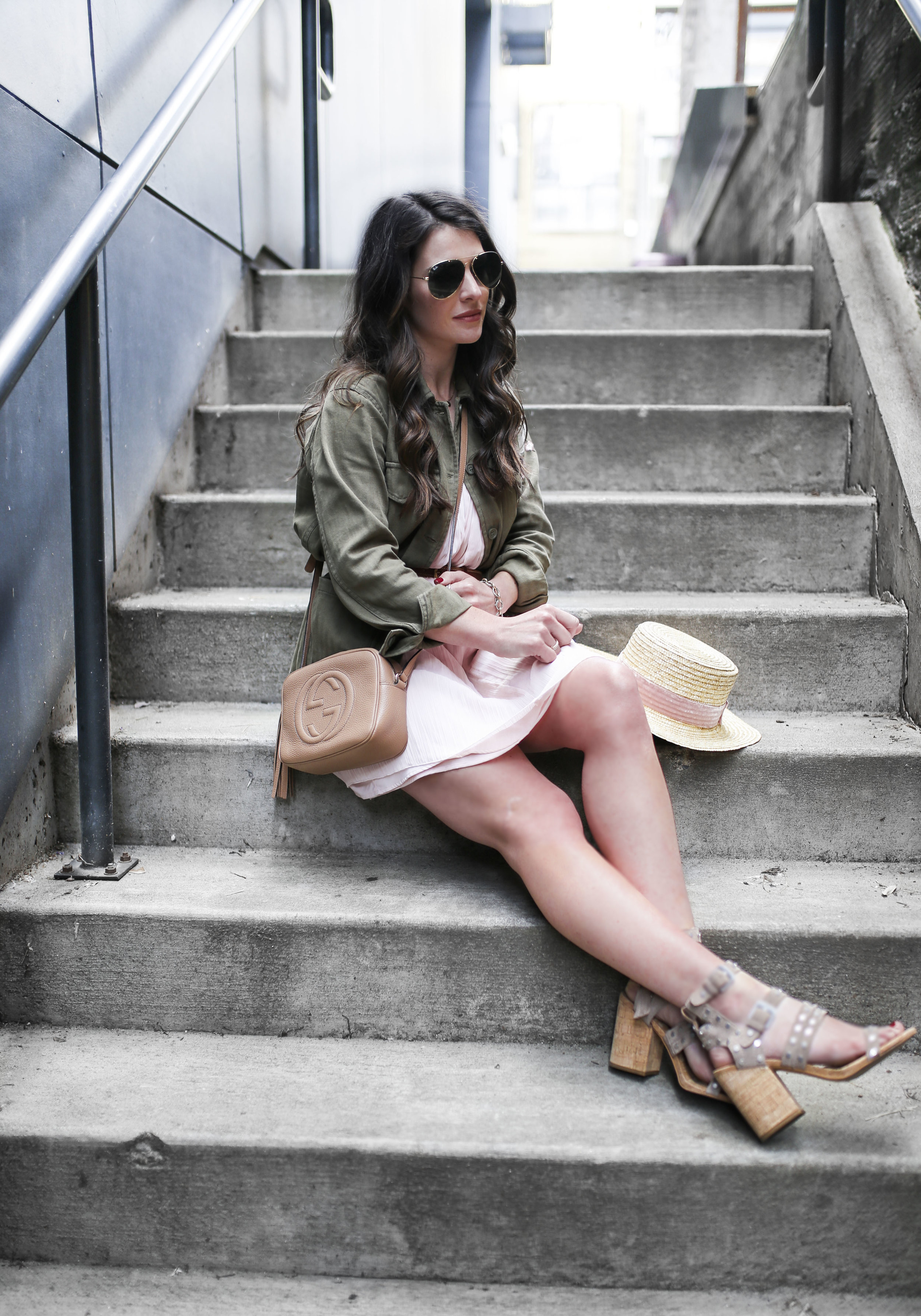Embroidery trend summer 2017.  Topshop army shirt jacket with floral embroidery, Abercrombie & Fitch swing dress in blush, Gucci soho disco bag rose beige, Dolce Vita Effie sandals, Lack of Color boater hat, and ray-ban aviator sunglasses.  Summer dress with jacket belted.