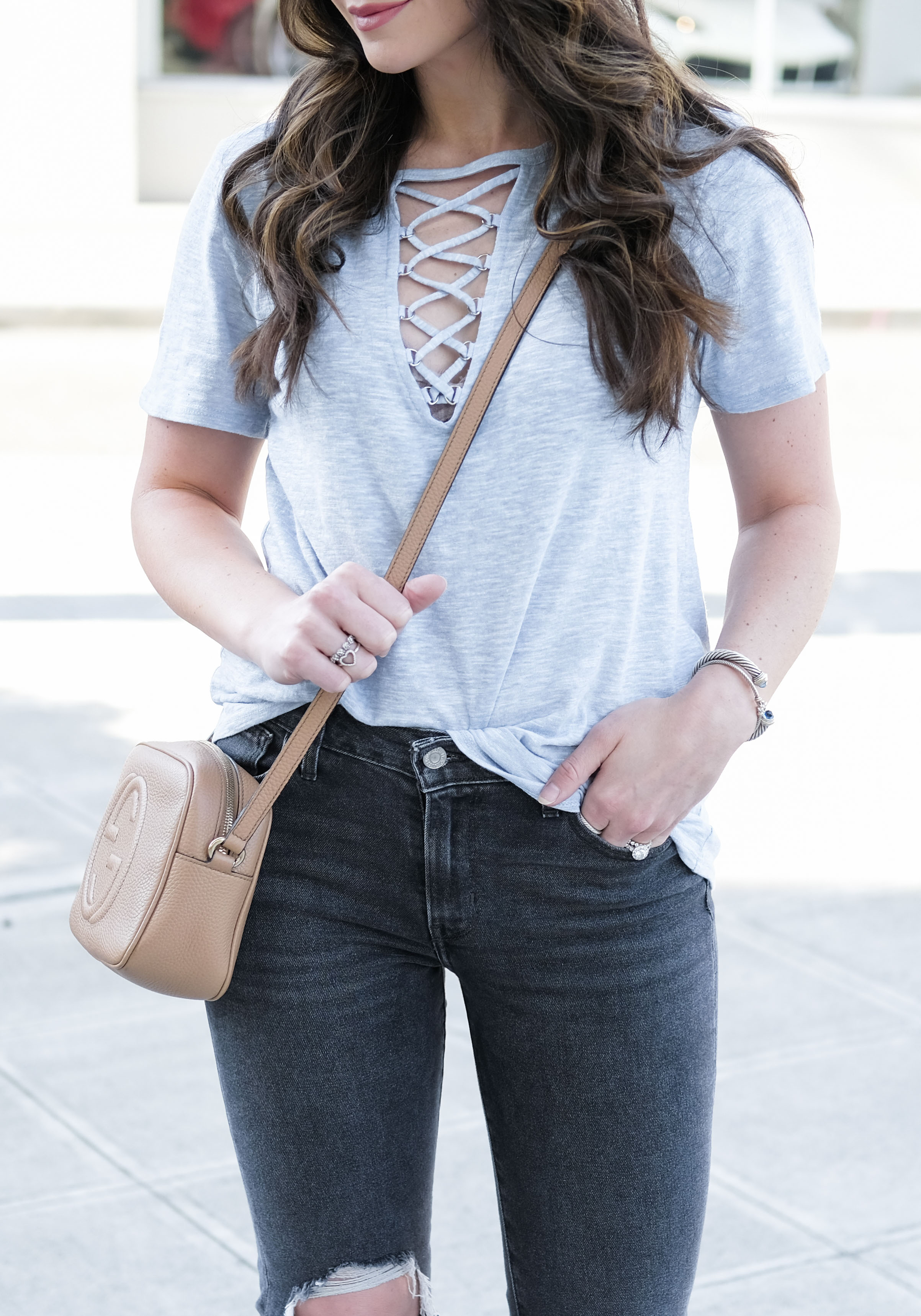 Cute casual summer outfits.  Cute t-shirts tees under 50 dollars: Levi's 721 high rise jeans, socialite grommet lace up tee, Dolce Vita Effie sandals taupe, gucci & soho disco rose beige.