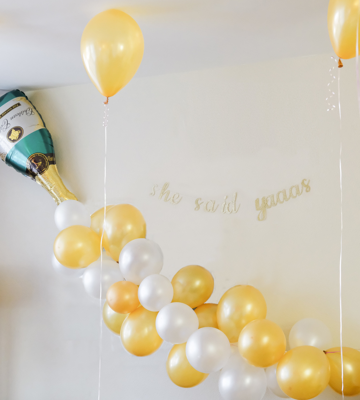 Bachelorette decor idea: Champagne bottle balloon garland, She Said Yaaas Banner, Bachelorette party in Cincinnati Ohio
