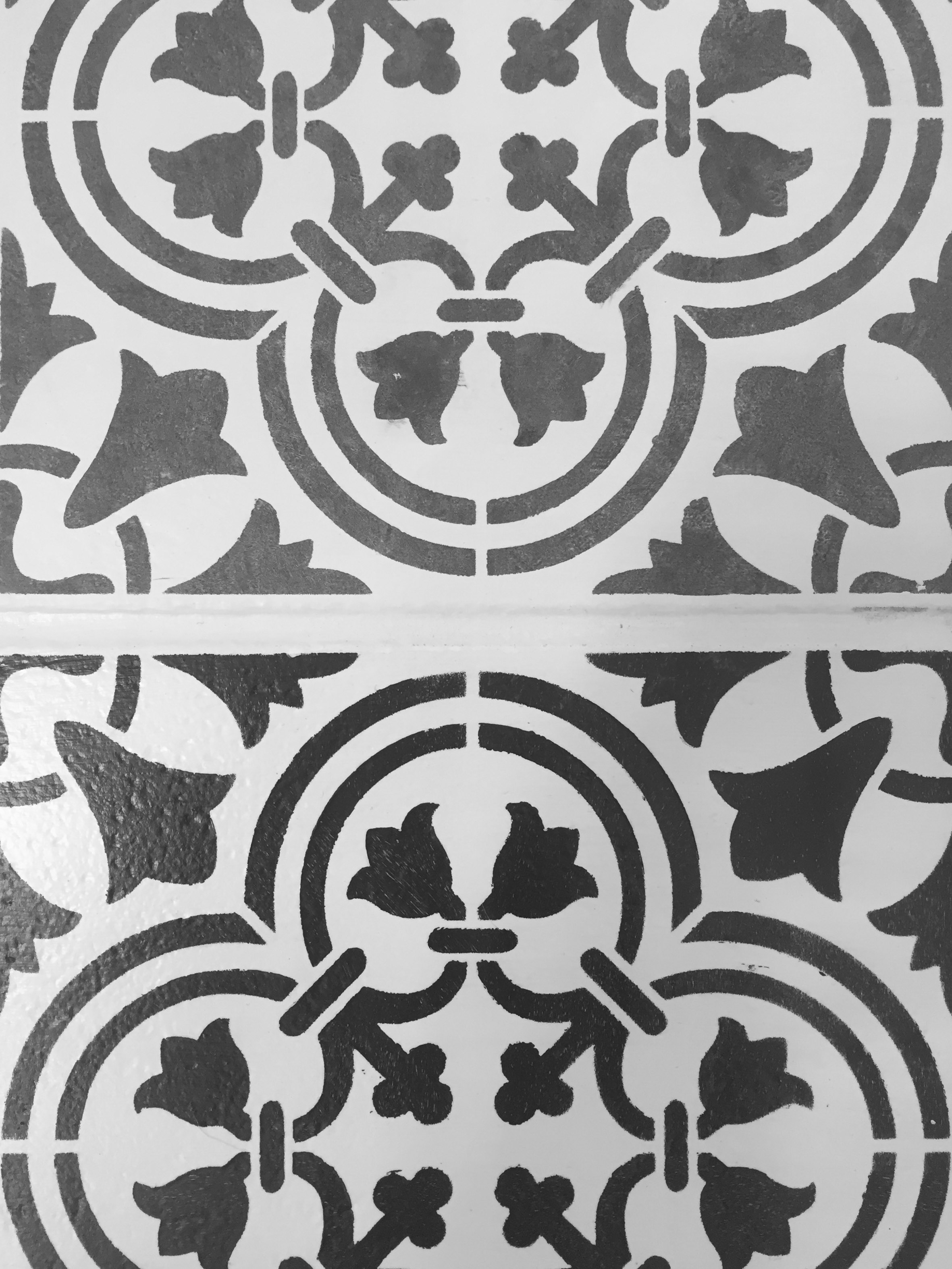 Top tile has been whitewashed, the bottom tile has not.  The whitewash gives it a much more authentic moroccan tile look!