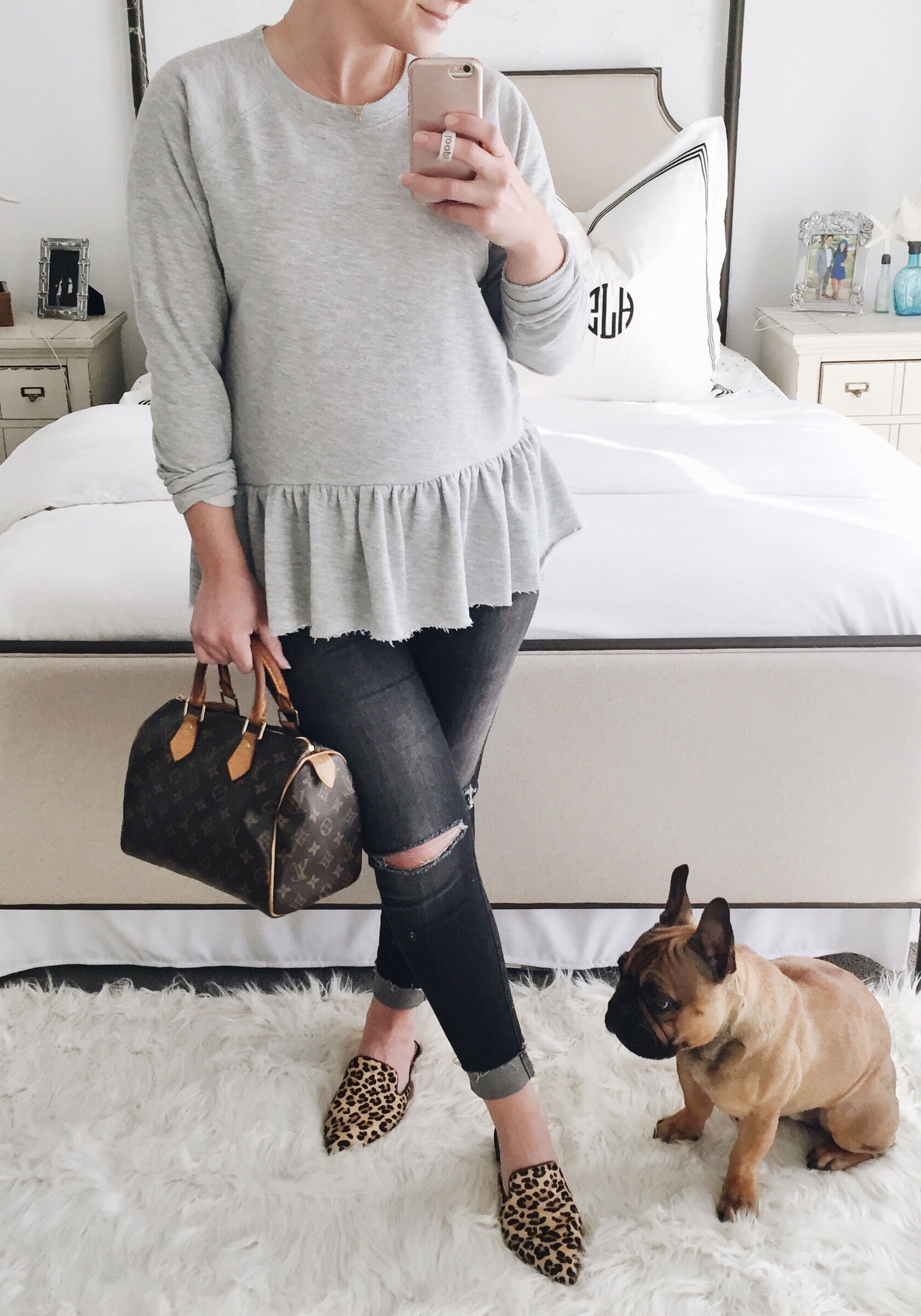 Second trimester maternity outfit. Peplum sweatshirt with gray distressed jeans and leopard slides.
