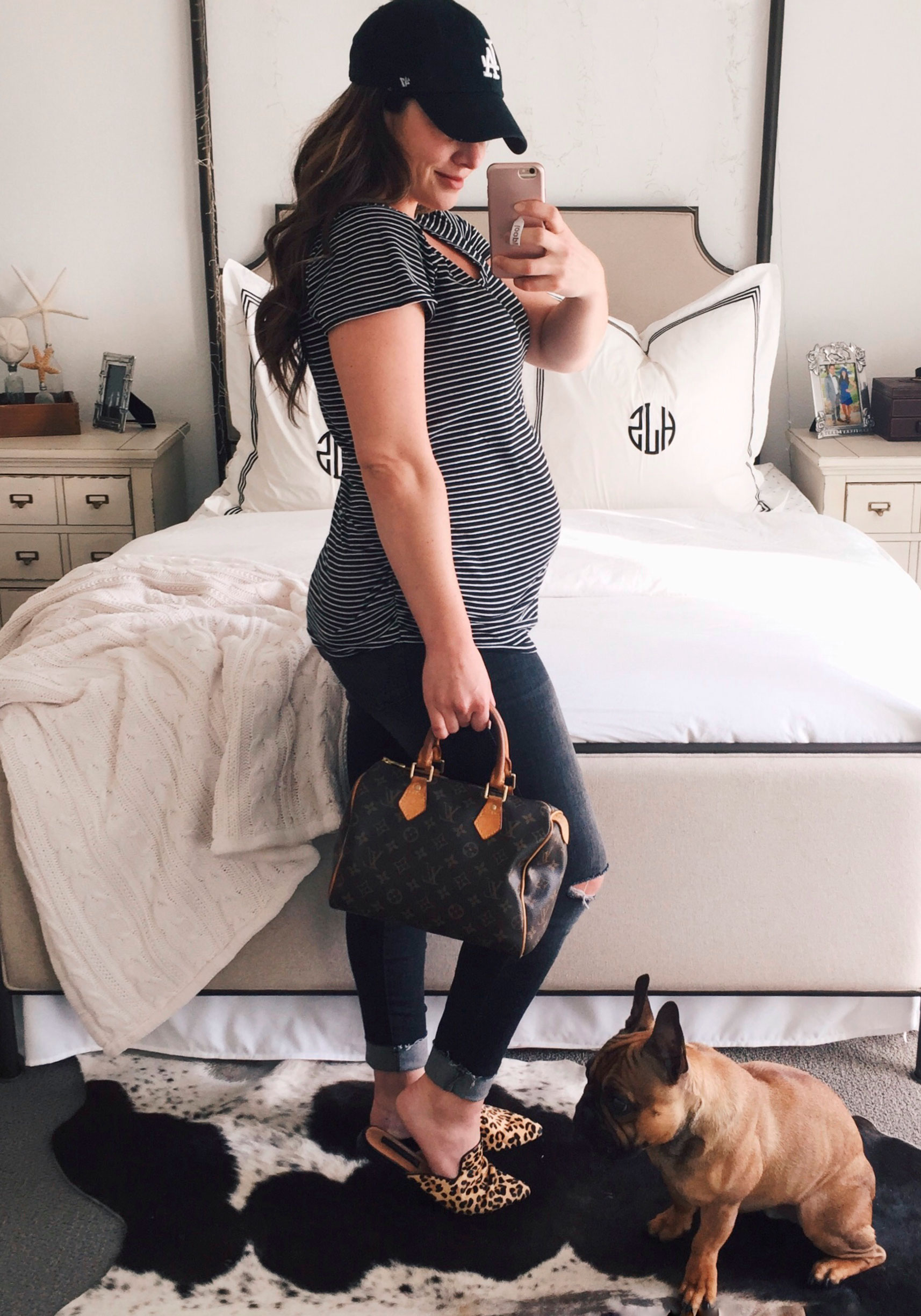 Second trimester maternity outfit.  Distressed gray maternity jeans, black and white striped maternity tee, leopard slides, LA hat, and Louis Vuitton speedy 25,