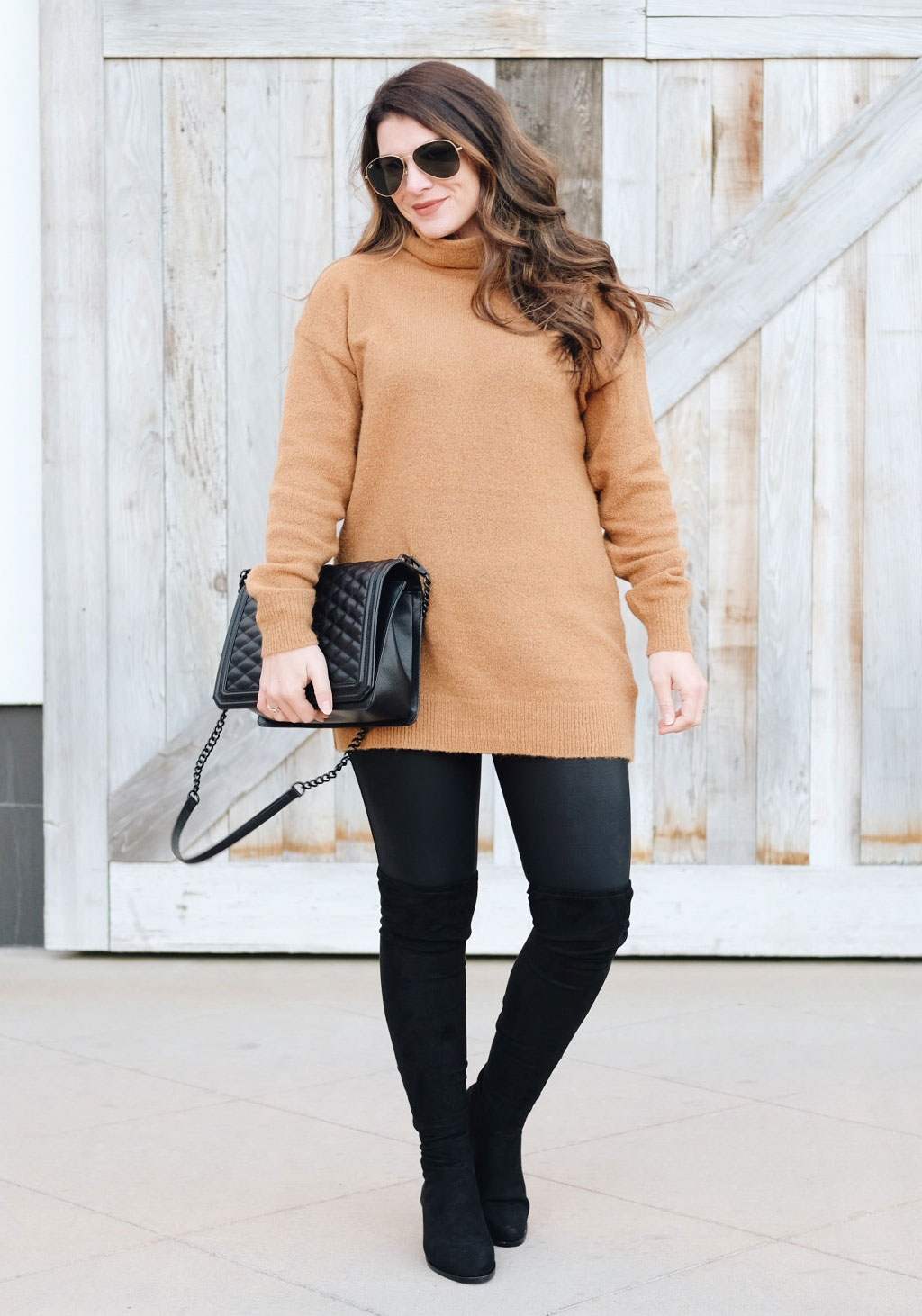 Second trimester maternity outfit. Spanx faux leather moto leggings, Steve Madden over the knee boots, Rebecca Minkoff Love crossbody bag, and tunic sweater.