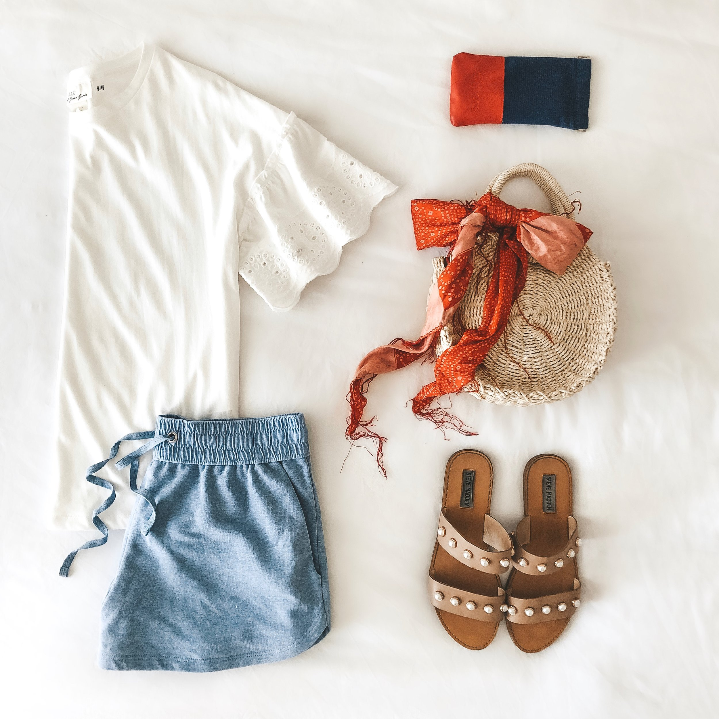 Casual Fourth of July outfit.  Sweatshorts with lace trim tee, Steve Madden pearl sandals, and straw tote.