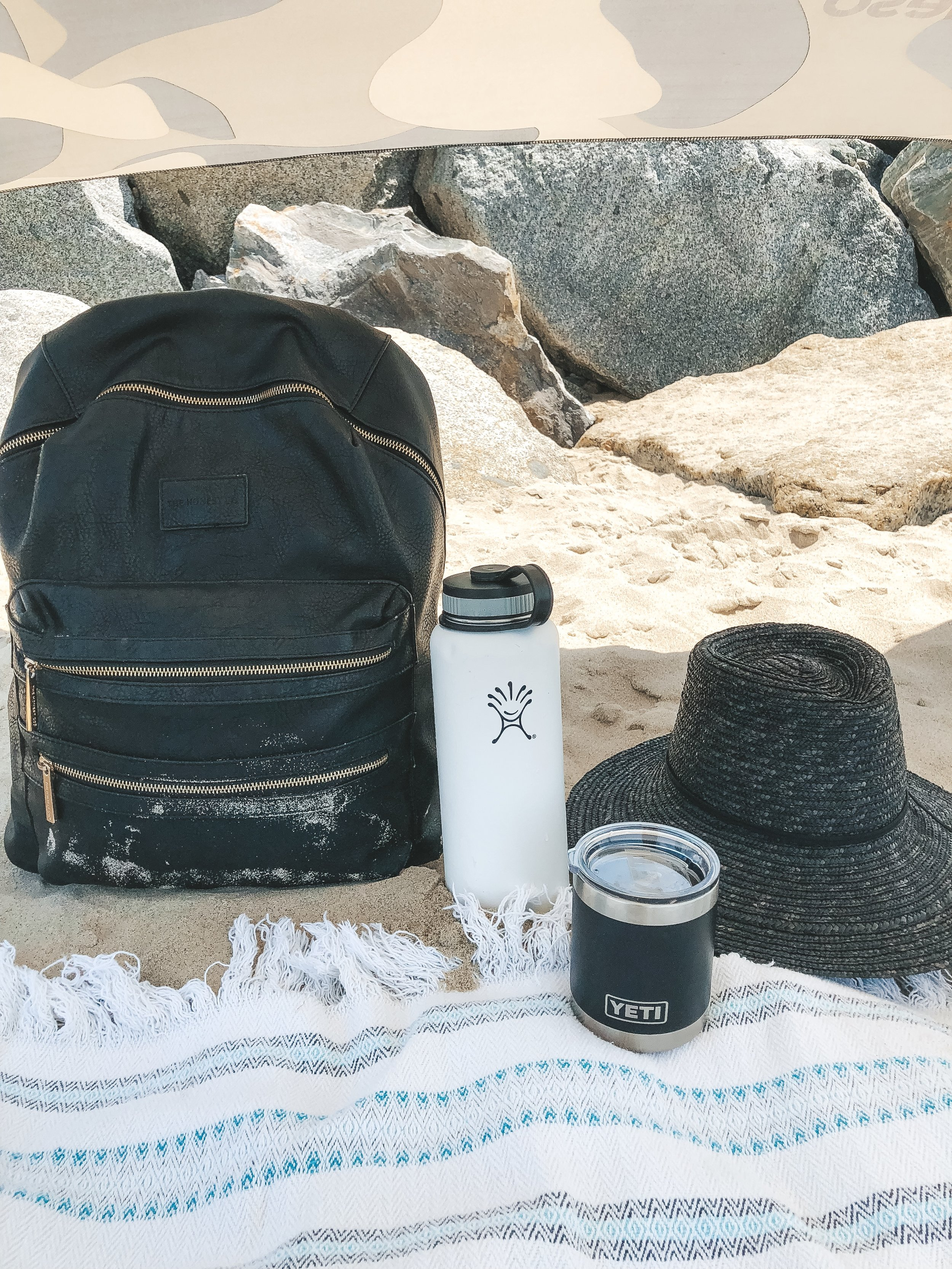 Honest Company backpack.  Tips to take your newborn baby to the beach.