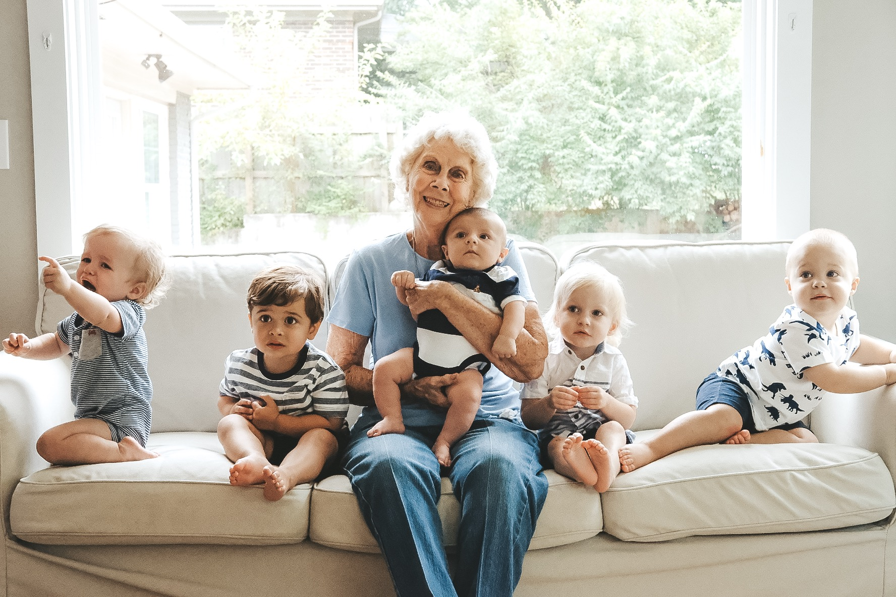Family photo.  Baby photo with grandma.  Navy outfits for family photos.