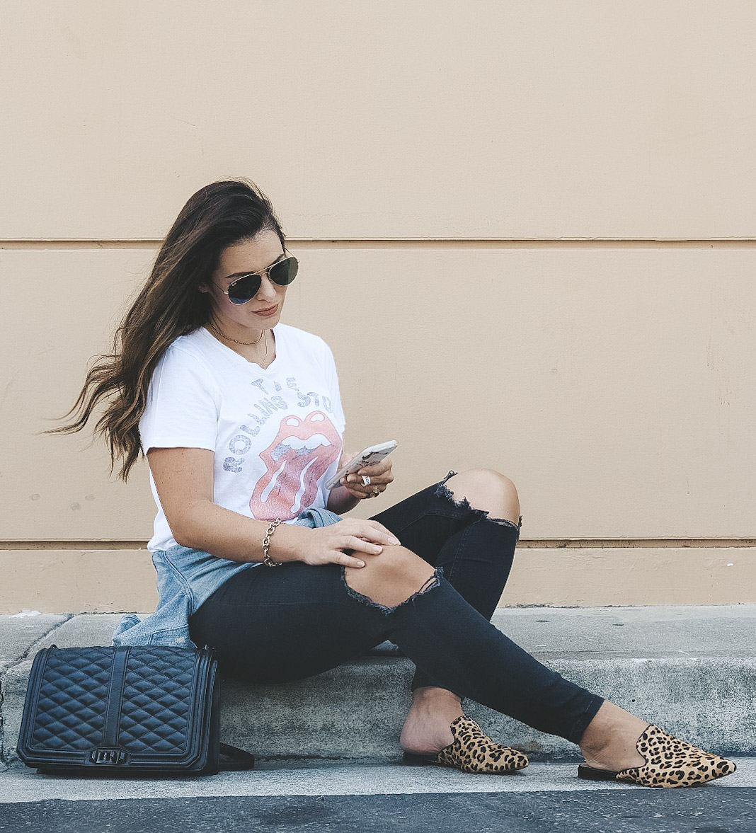 Leopard shoes and accessories for fall 2018.  Steve Madden Velocity mules, Rebecca Minkoff love crossbody bag, Free People busted knee jeans, Rolling Stones tee, and Ray-Ban aviator sunglasses.