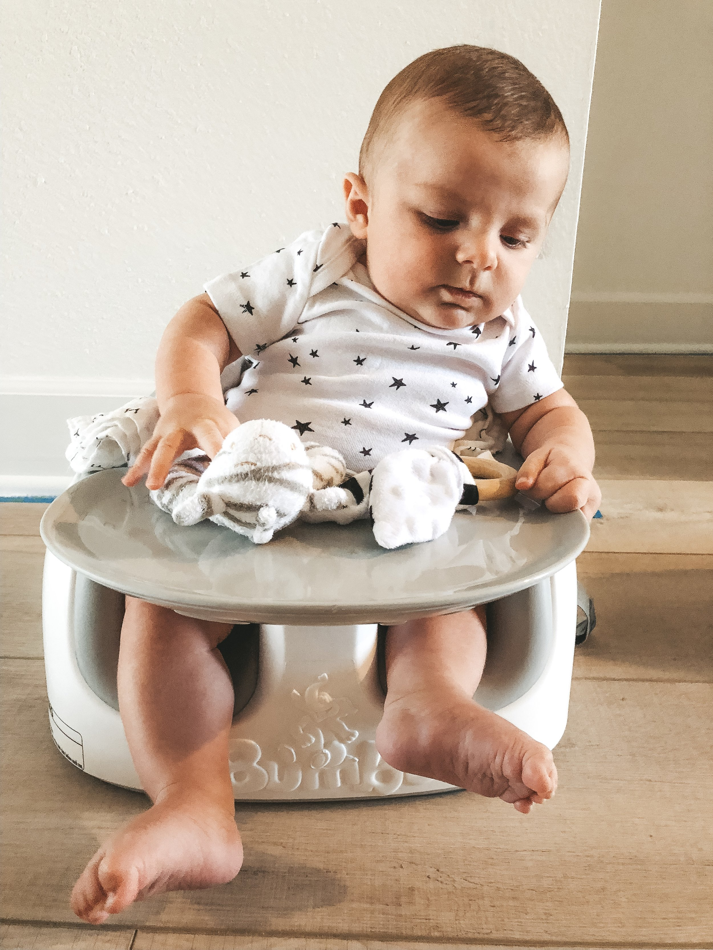 Bumbo seat for baby.