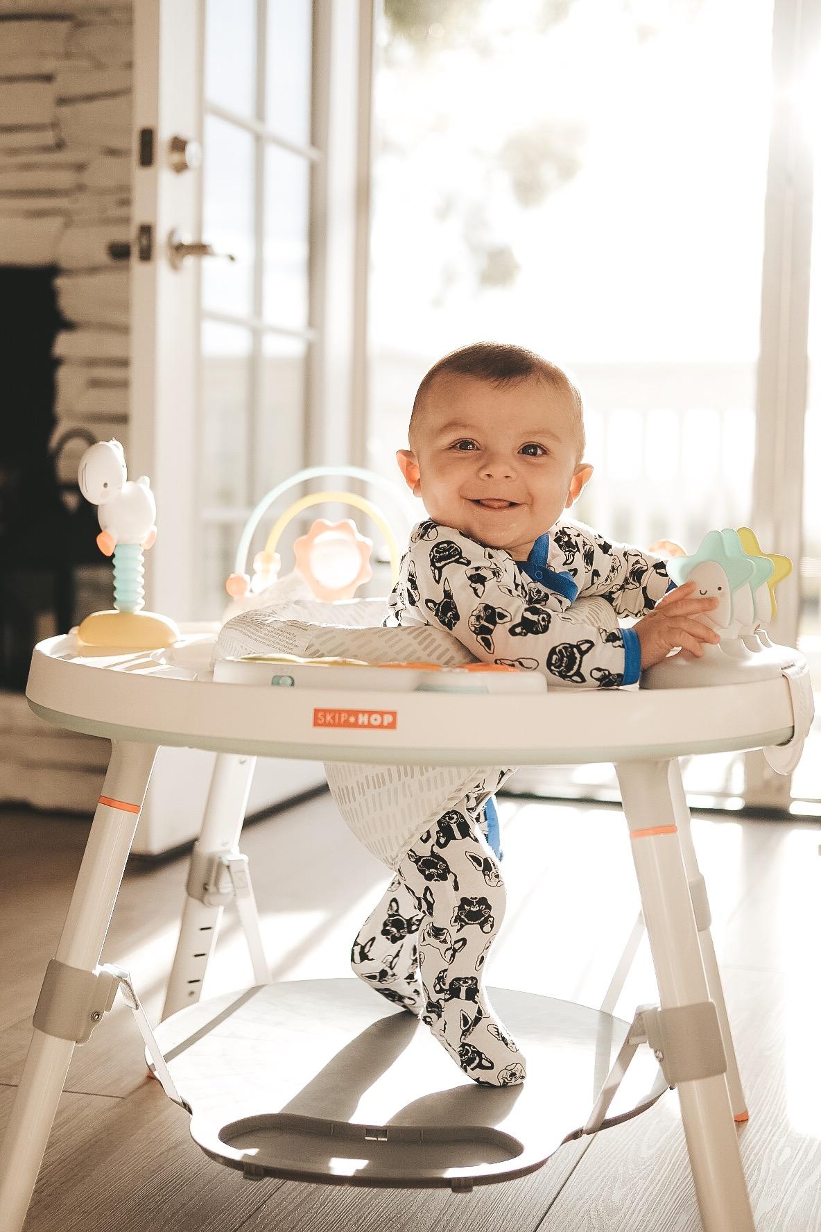 Newborn frenchie pajamas from Nordstrom Rack.  Skip Hop activity center.  White baby toys.