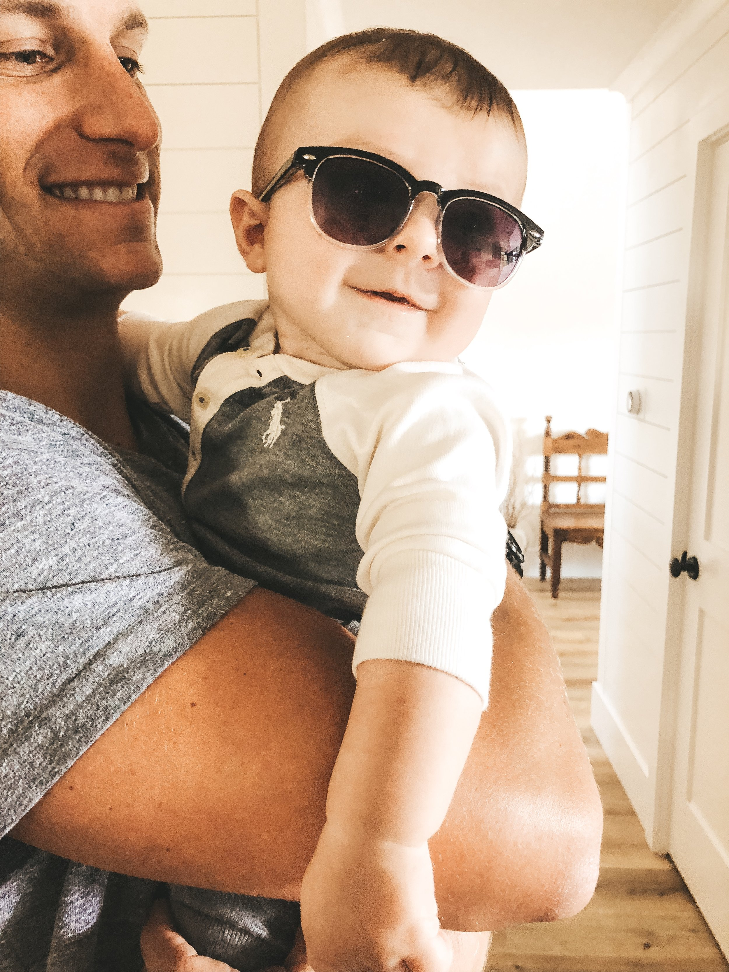 Ralph Lauren baby with Ray-Ban clubmaster sunglasses.