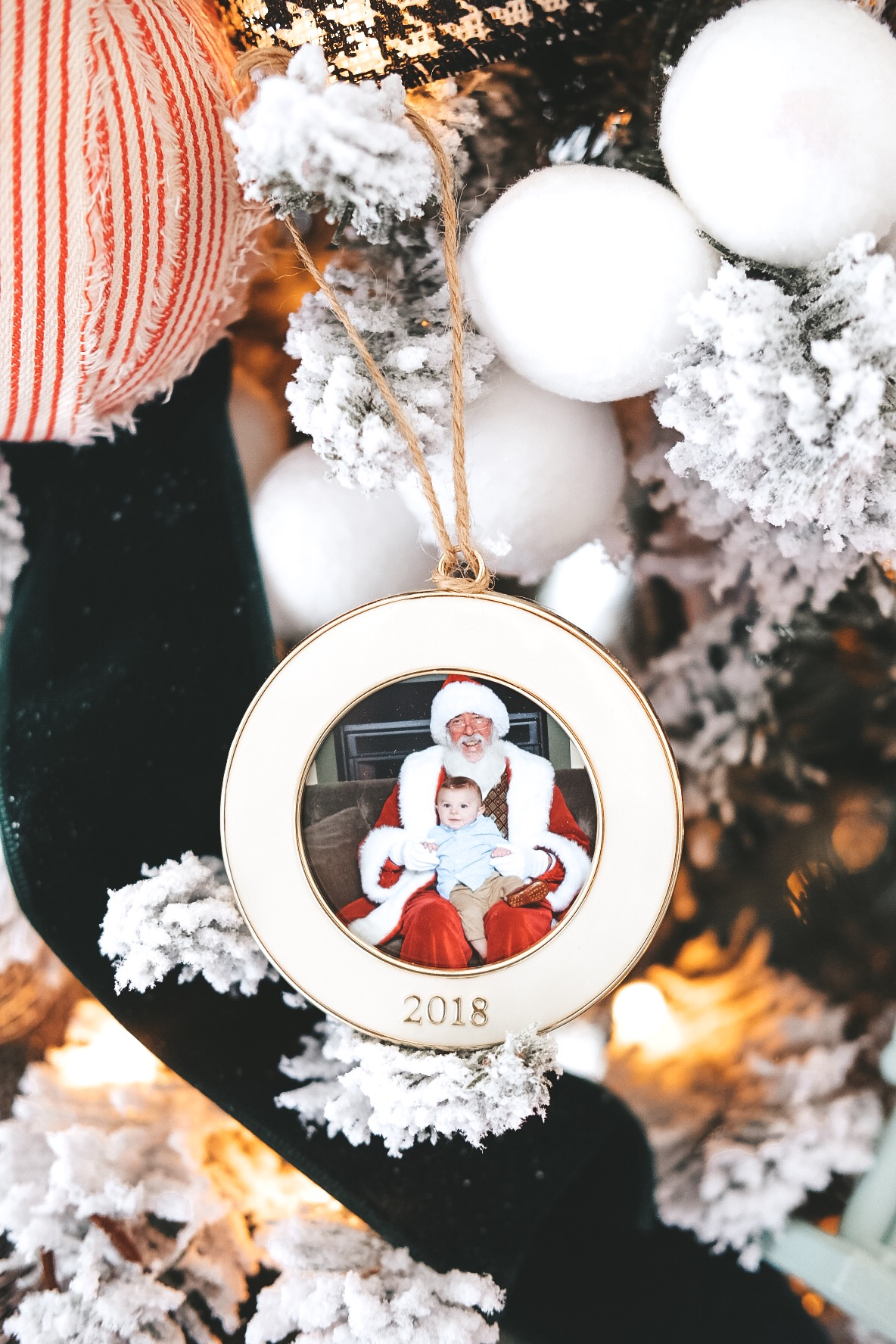 Dated ornament for yearly Santa photos.