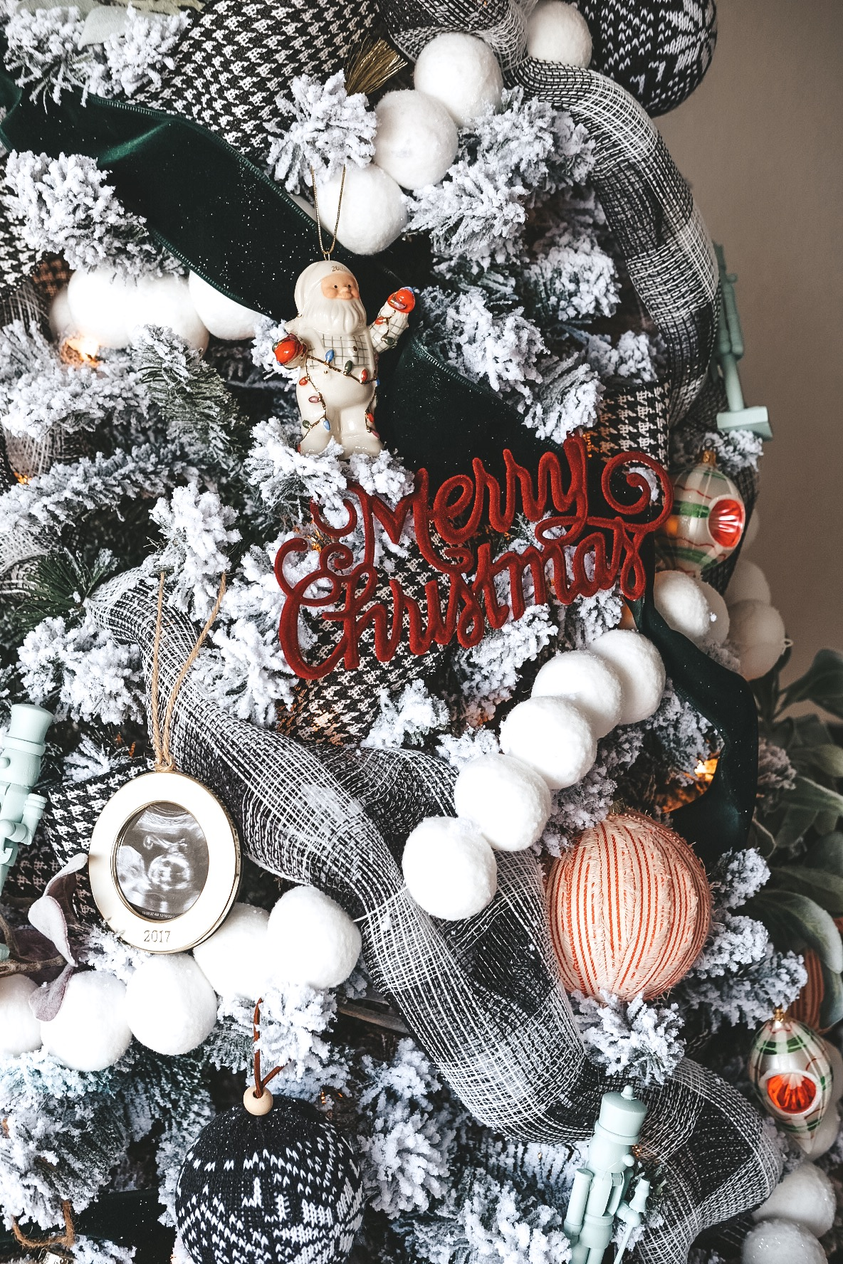Black and white Christmas tree decor.  Yearly dated ornaments.