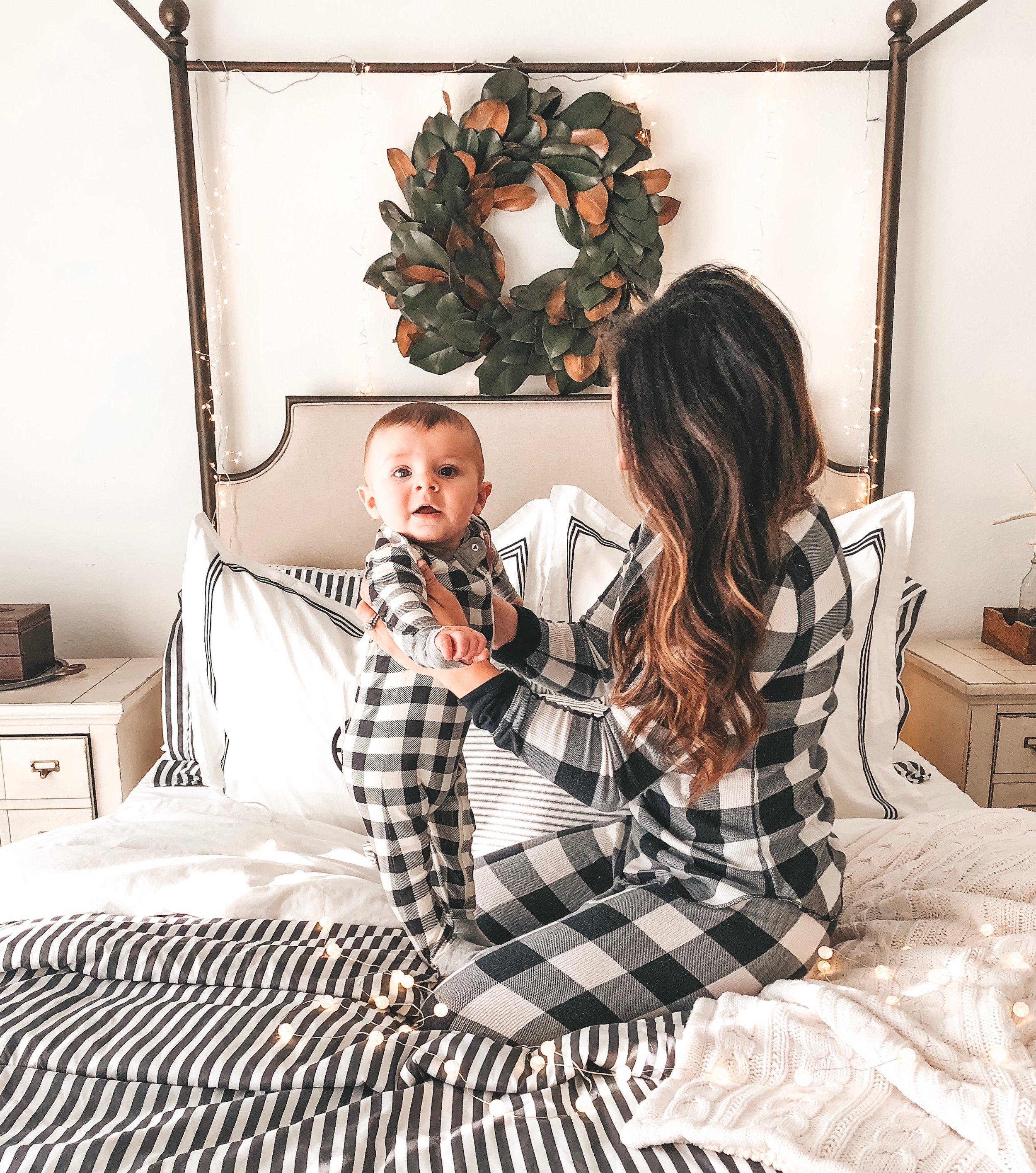 Mommy and baby matching Christmas pajamas.
