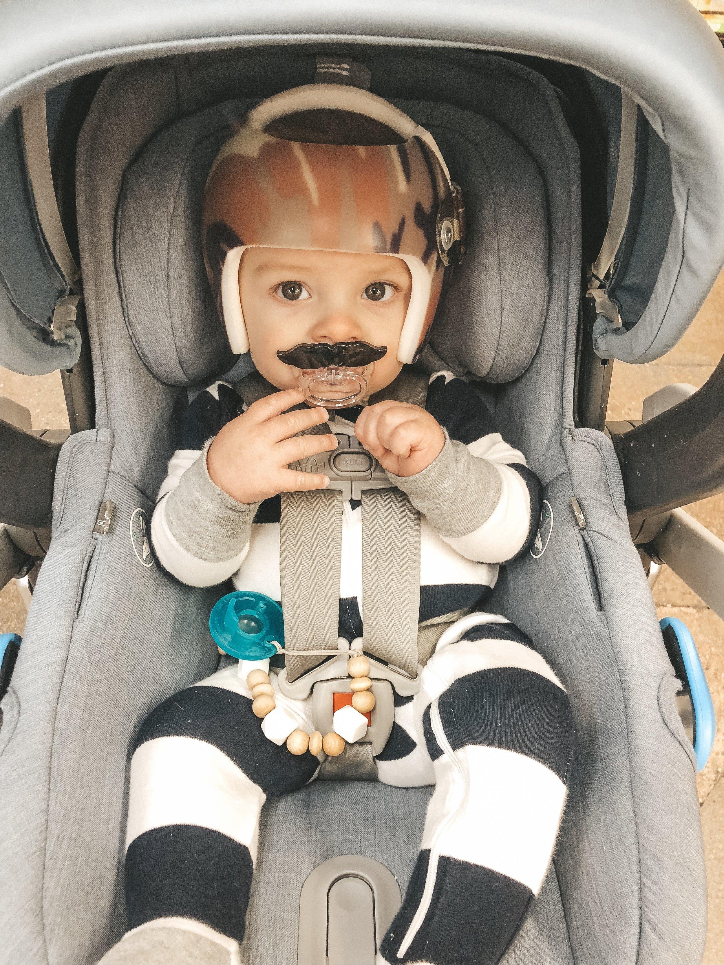 Jett Jones, 8 Months Old.  Uppababy Mesa carseat in Henry blue.  Mustachifier.