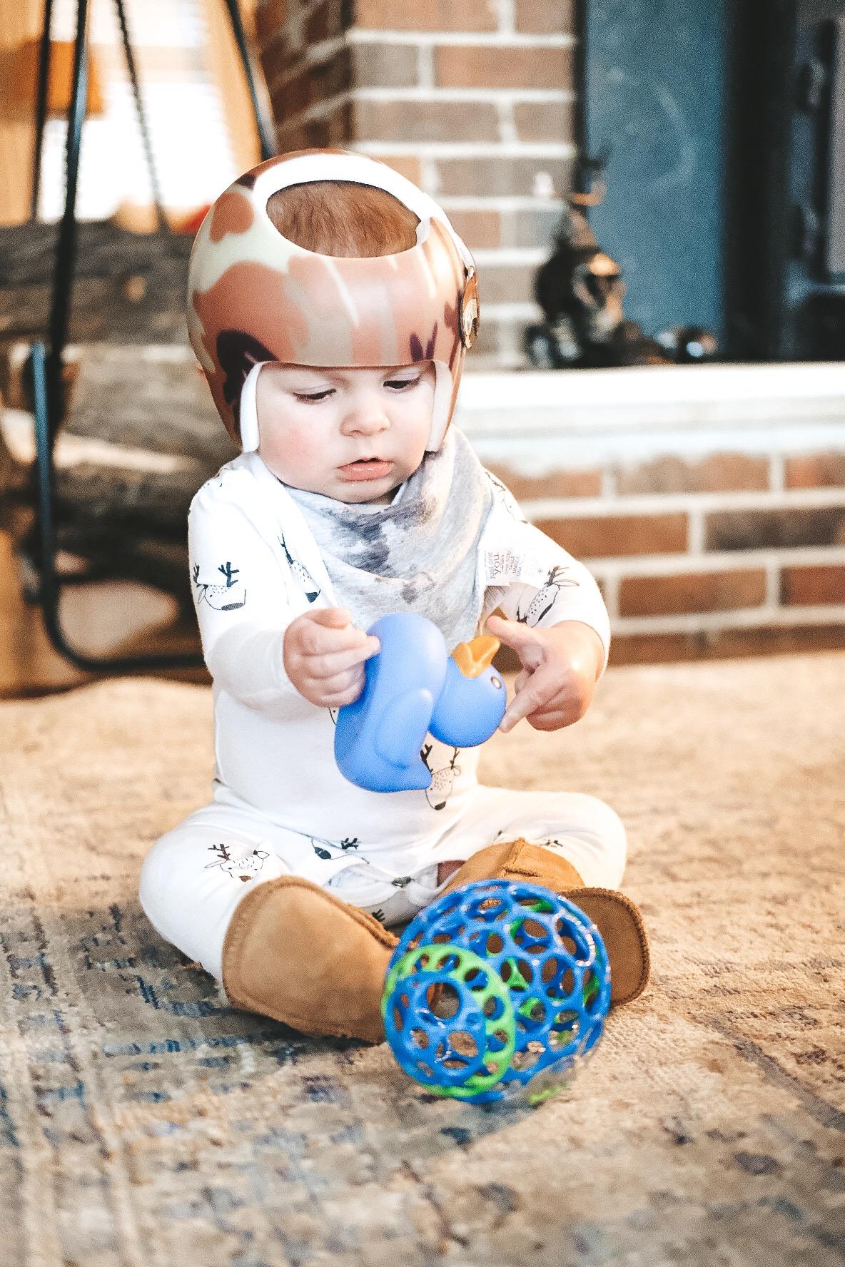 Jett Jones, 8 Months Old.  Baby Ugg Boots.  Starband helmet.