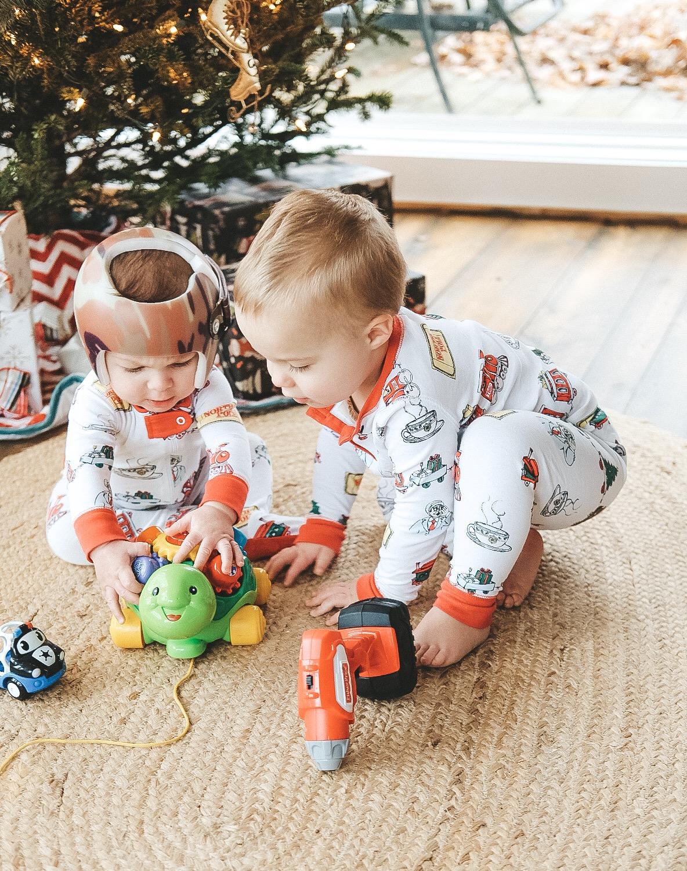Jett Jones, 8 Months Old. The Beaufort Bonnet Christmas Pajamas.  Starband Helmet.