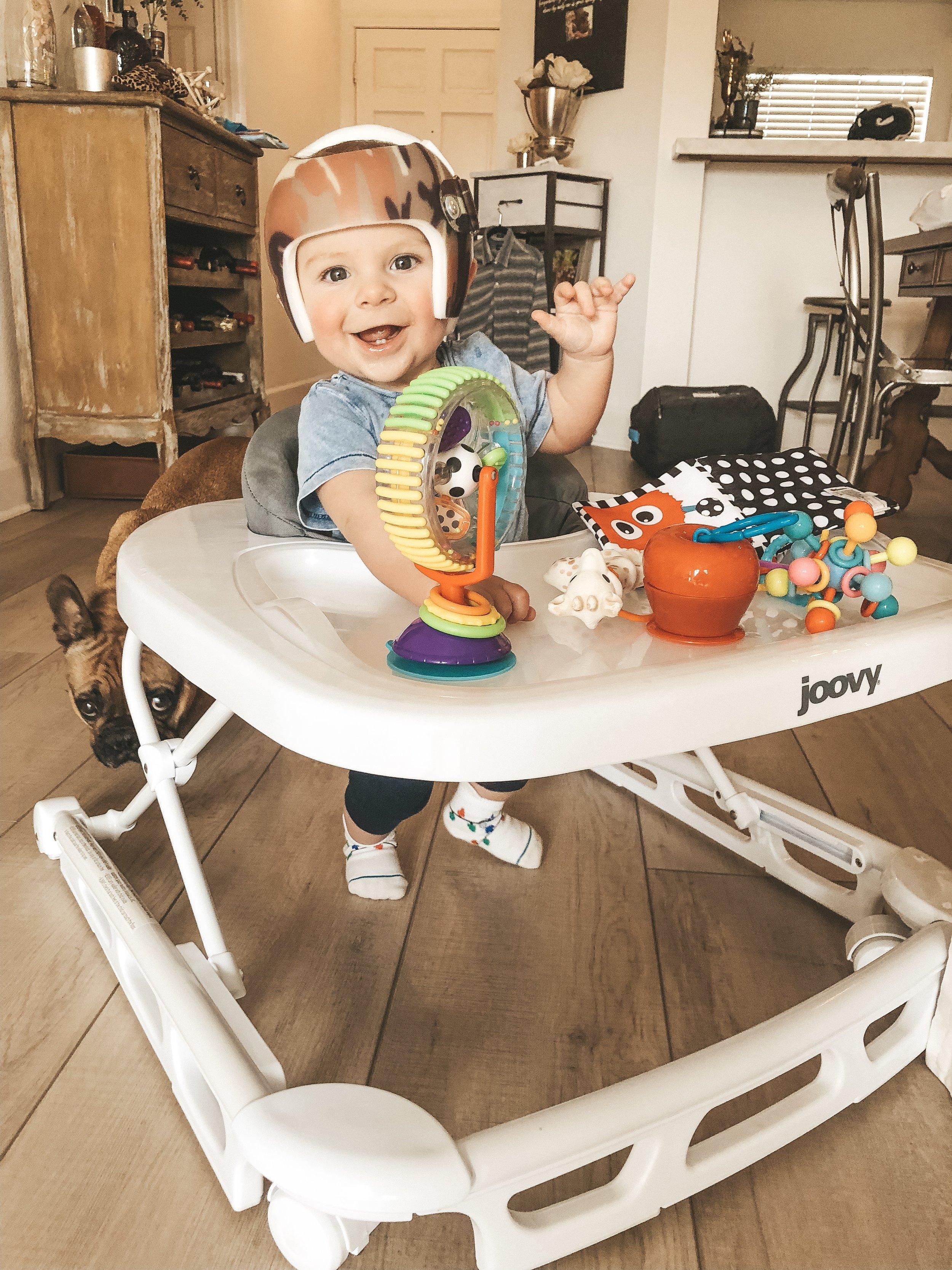Jett Jones, 8 Months Old. Joovy Sppon Walker.  Starband helmet in camo.