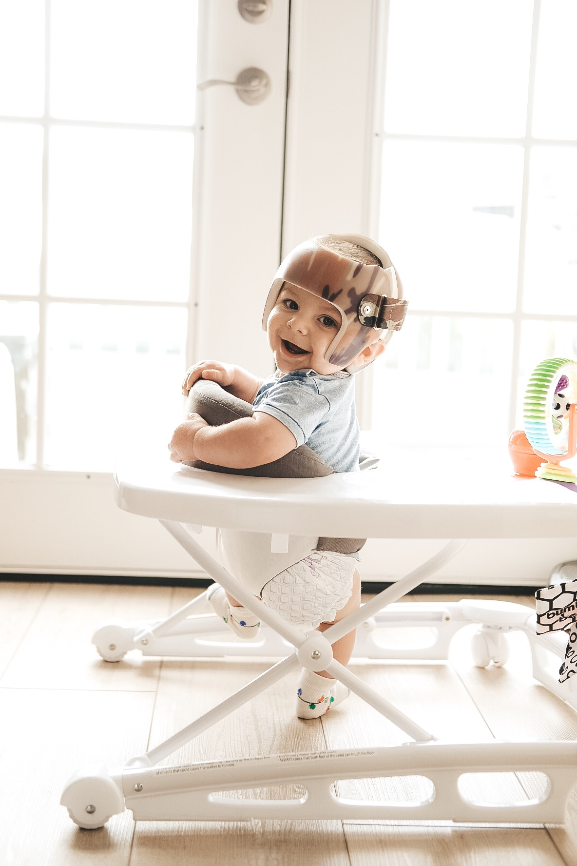 Jett Jones, 8 Months Old.  Joovy Spoon Walker.  Camo Starband Helmet.