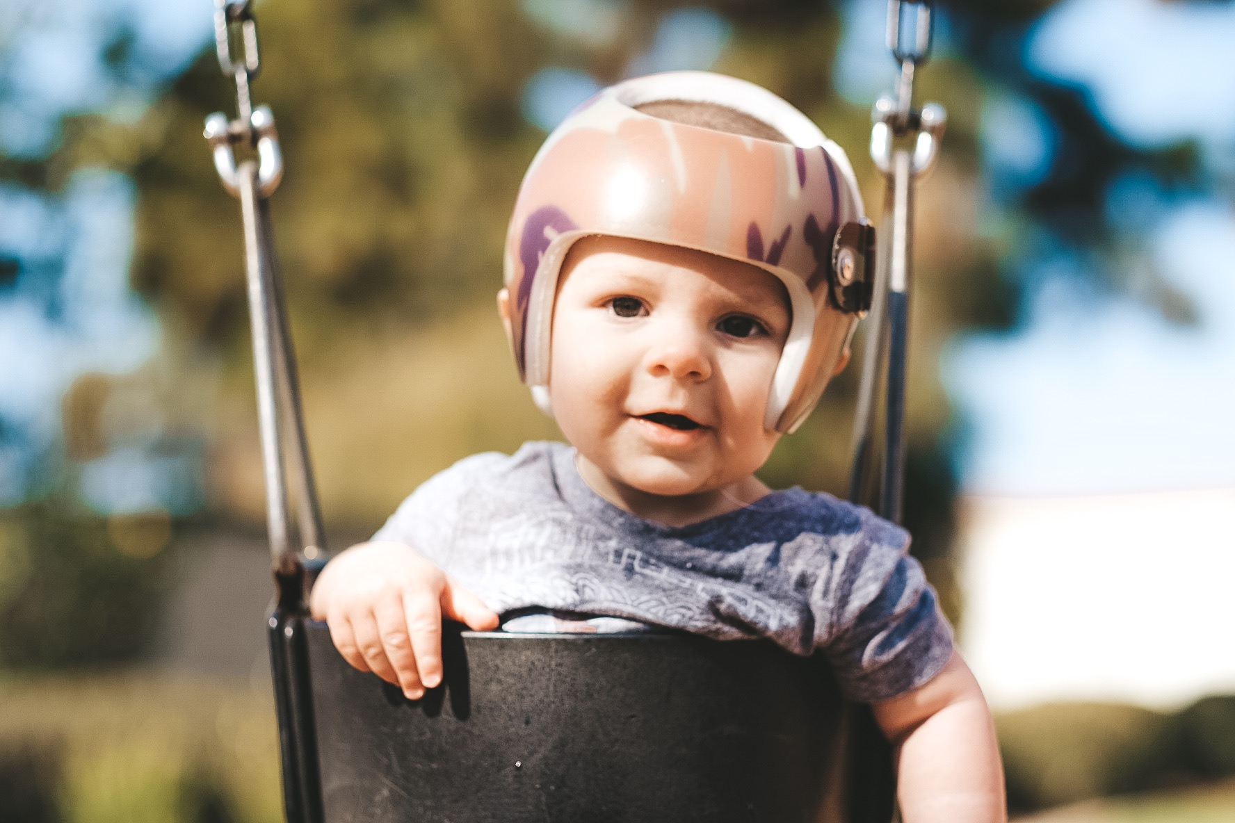 Jett Jones, 9 Month Update.  Camo starband helmet.  Baby at the park photo.