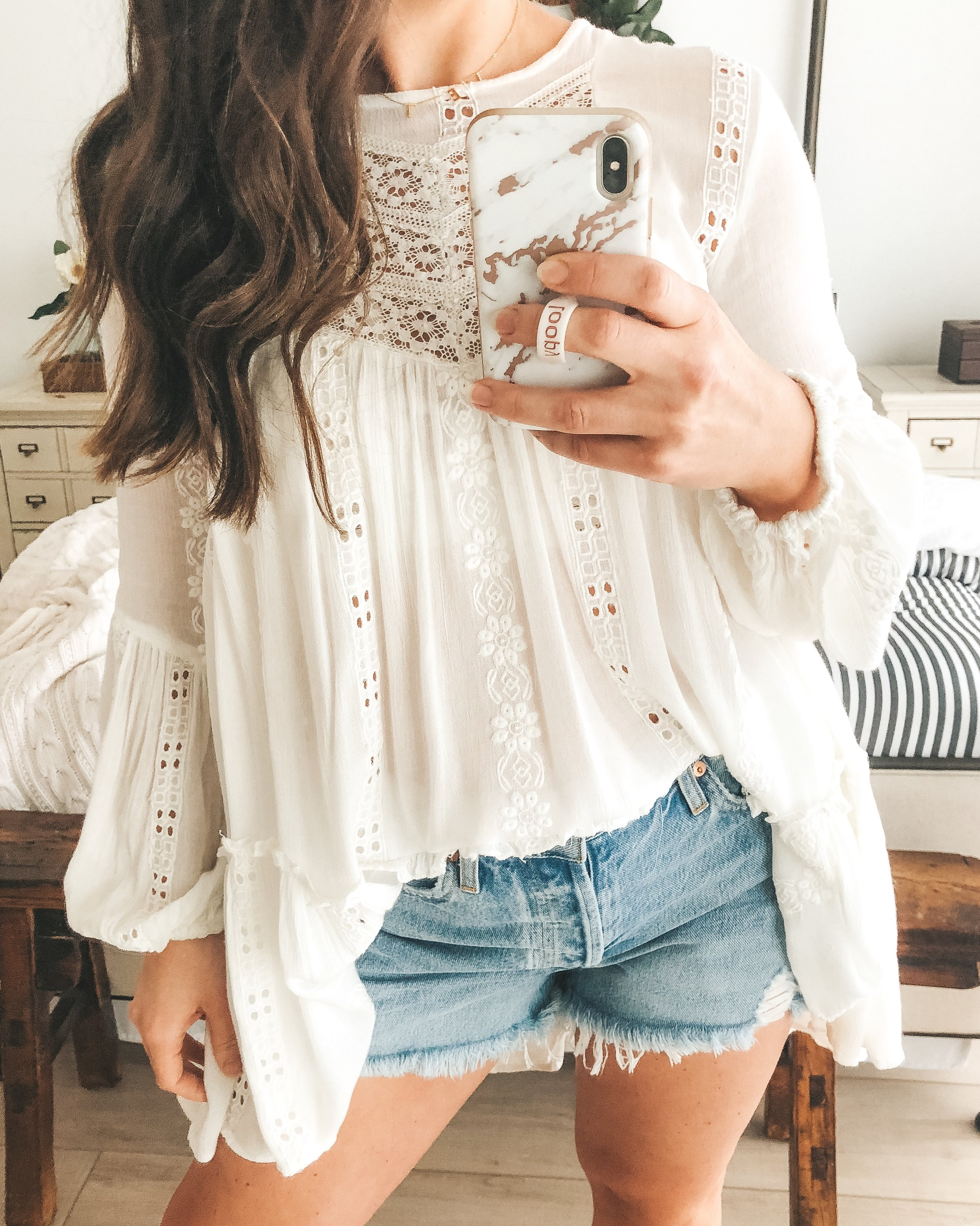 free people kiss kiss tunic and agolde parker jean shorts.