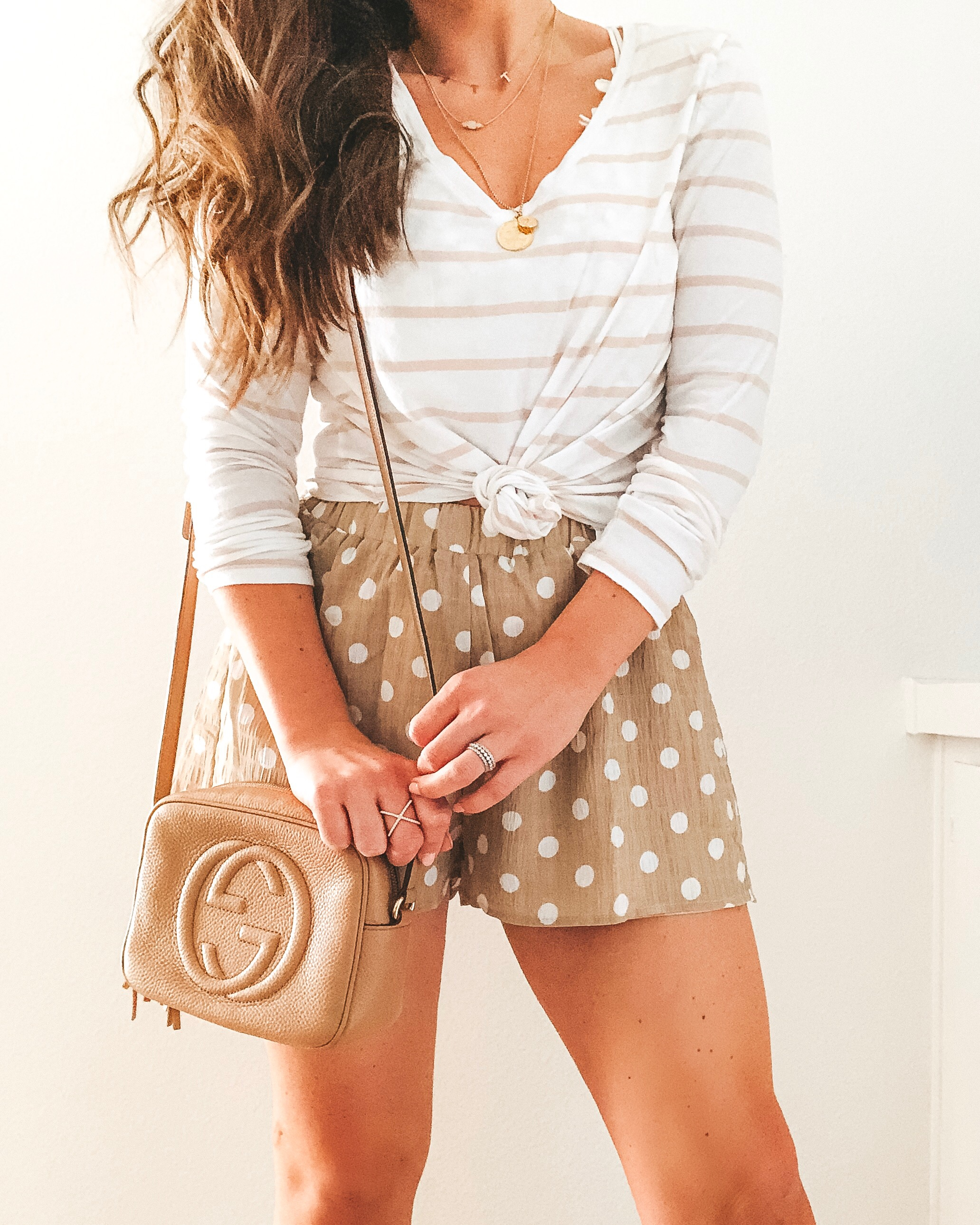 Superdown flutter shorts, Gucci soho disco bag, khaki and white stripe tee, and layered necklaces.  Cute neutral outfit for spring.