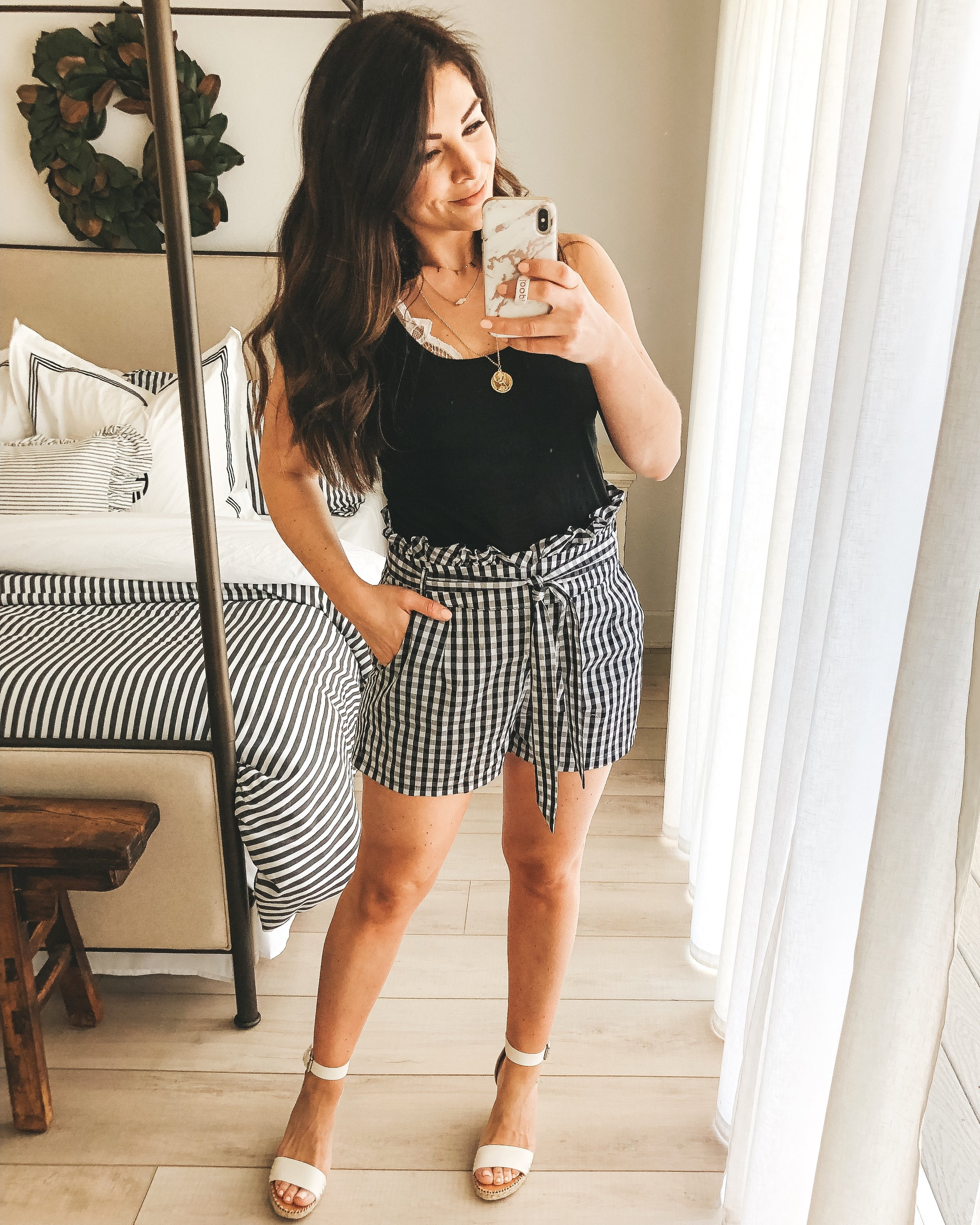 Affordable spring style from Amazon.  Amazon fashion finds.  Amazon prime fashion. Gingham shorts with black tank and Free People Adella Bralette.  Cute spring summer outfit.