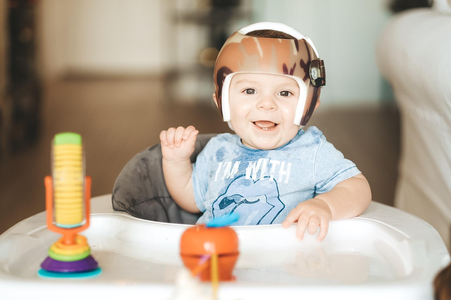 Jett Jones, 8 Months Old. Joovy Spoon Walker.  Camo Starband Helmet. Helmet treatment for Plagiocephaly aka flat head.