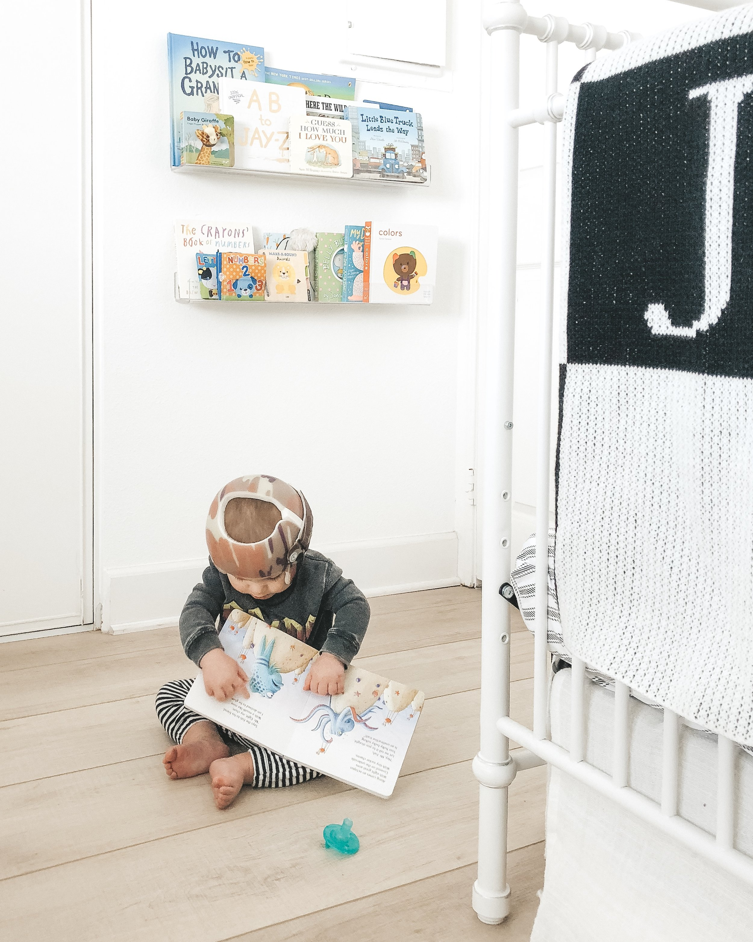 Jett Jones 10 month update.  Clear bookshelves.  Neutral boy nursery.  Black and white nursery. Helmet treatment for Plagiocephaly aka flat head.
