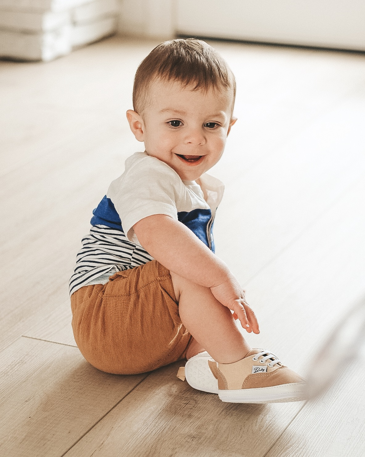 Jett Jones 12 Month update.  Cute baby boy style.  Stripe shirt with khaki shorts and vans look alike soft soled shoes.