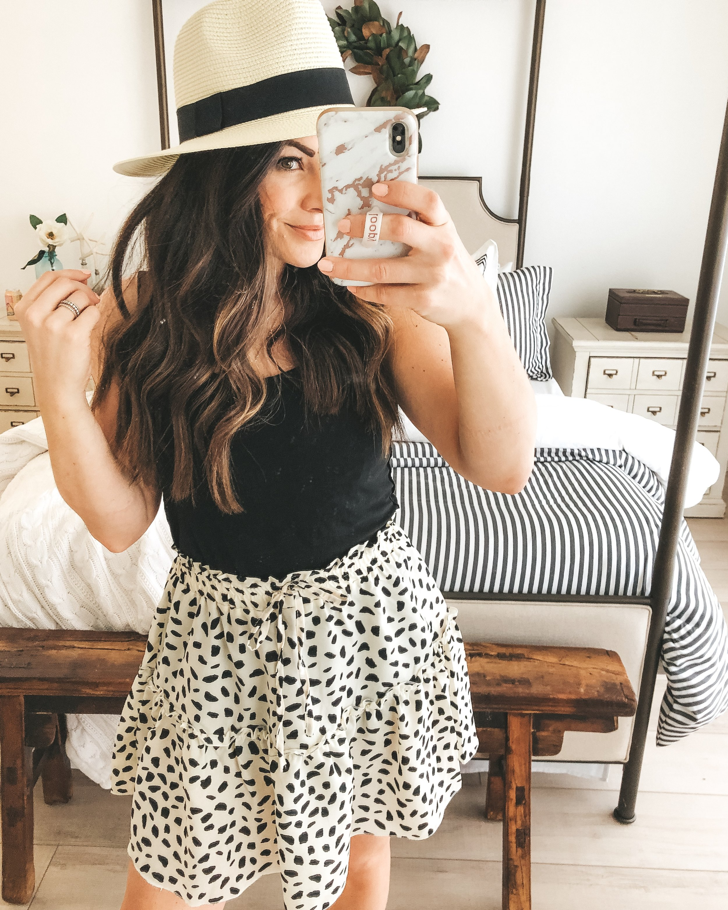 Amazon fashion finds for summer.  10 under $35 amazon women's clothing pieces.  Leopard printed black and white skirt with ruffle detal.  Cute summer skirt outfit.