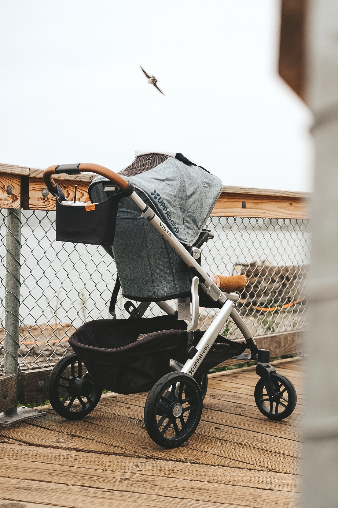 UPPAbaby VISTA Review.  The best stroller for traveling.  Travel stroller review. UPPAbaby VISTA snack tray for rumble seat.  UPPAbaby VISTA in Gregory Henry.