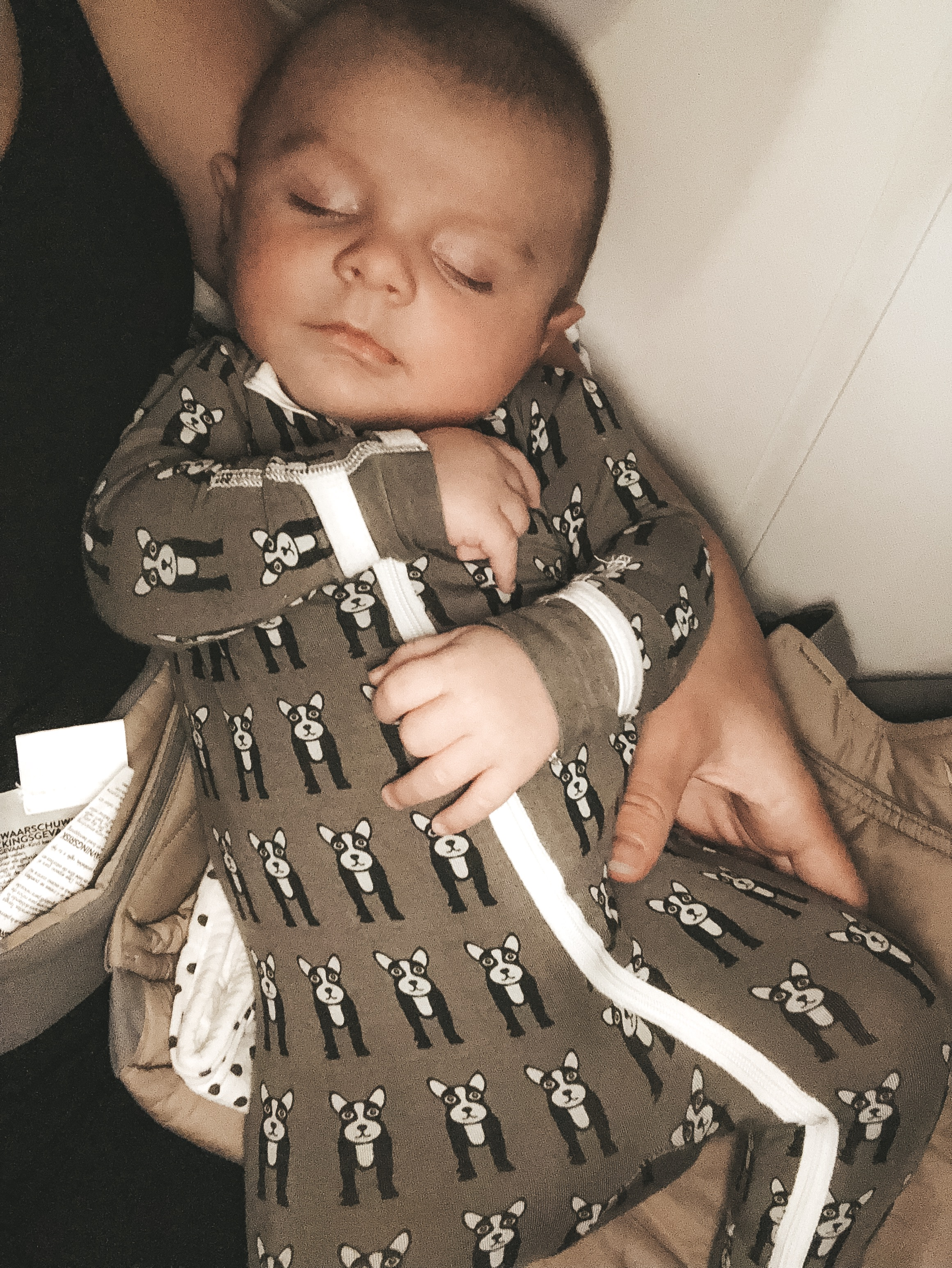 Tips for flying with a newborn baby.  What you need in your diaper bag when flying with a newborn.  The best travel stroller for flying with a newborn baby.