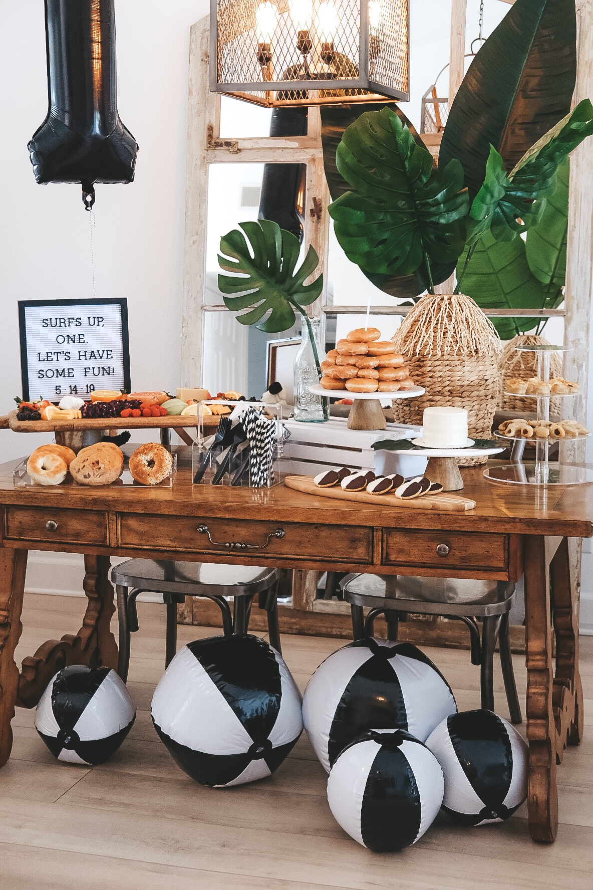 Modern surfer theme birthday party.  Black and white birthday party.  Baby boy frist birthday party. Black and white beachballs.  Brunch cheese board.